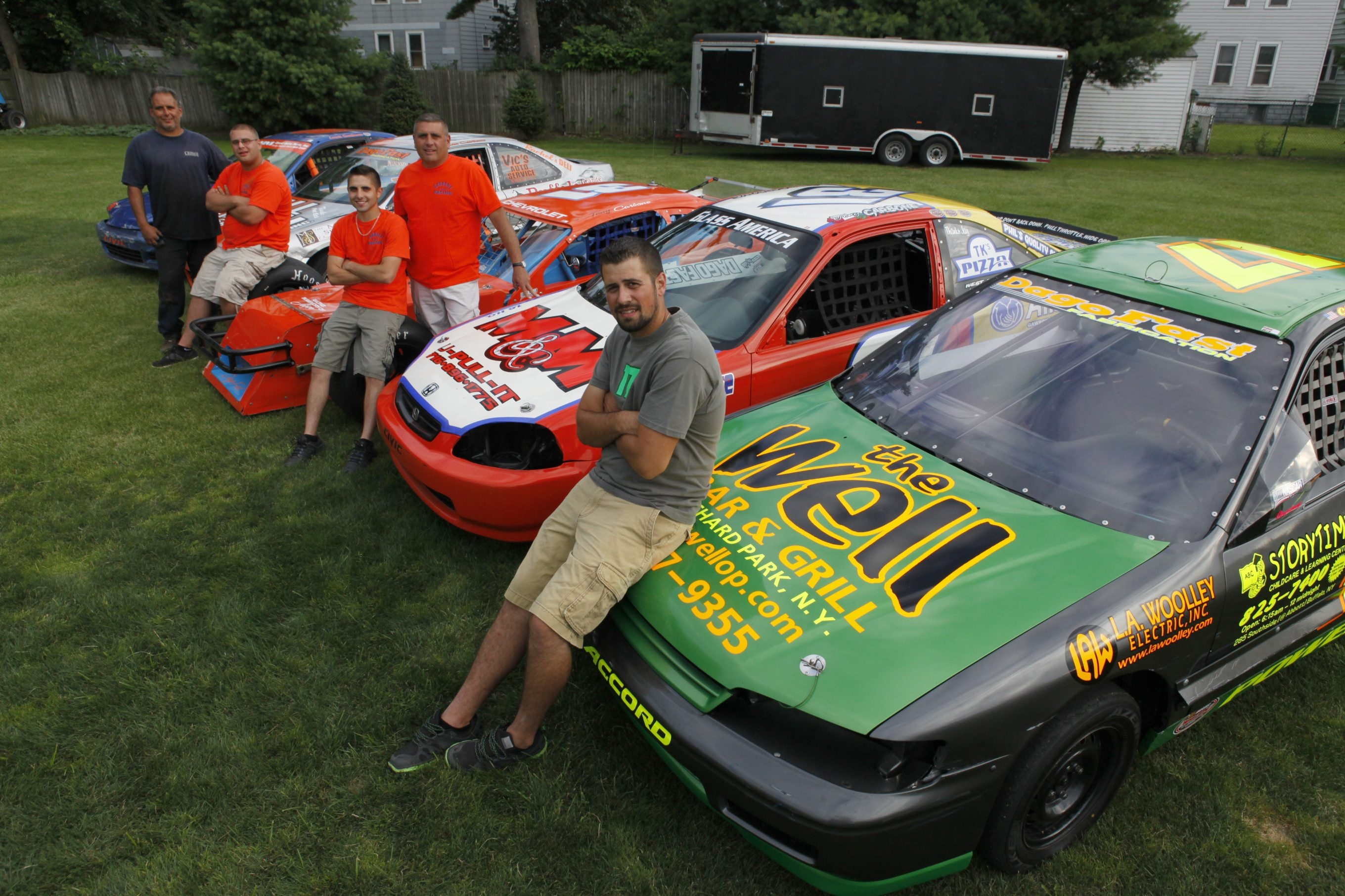Members of the Carbone racing family include, left to right:  Louis Sr. and son Louis, Joe, and son Tony, and Chris Powers.