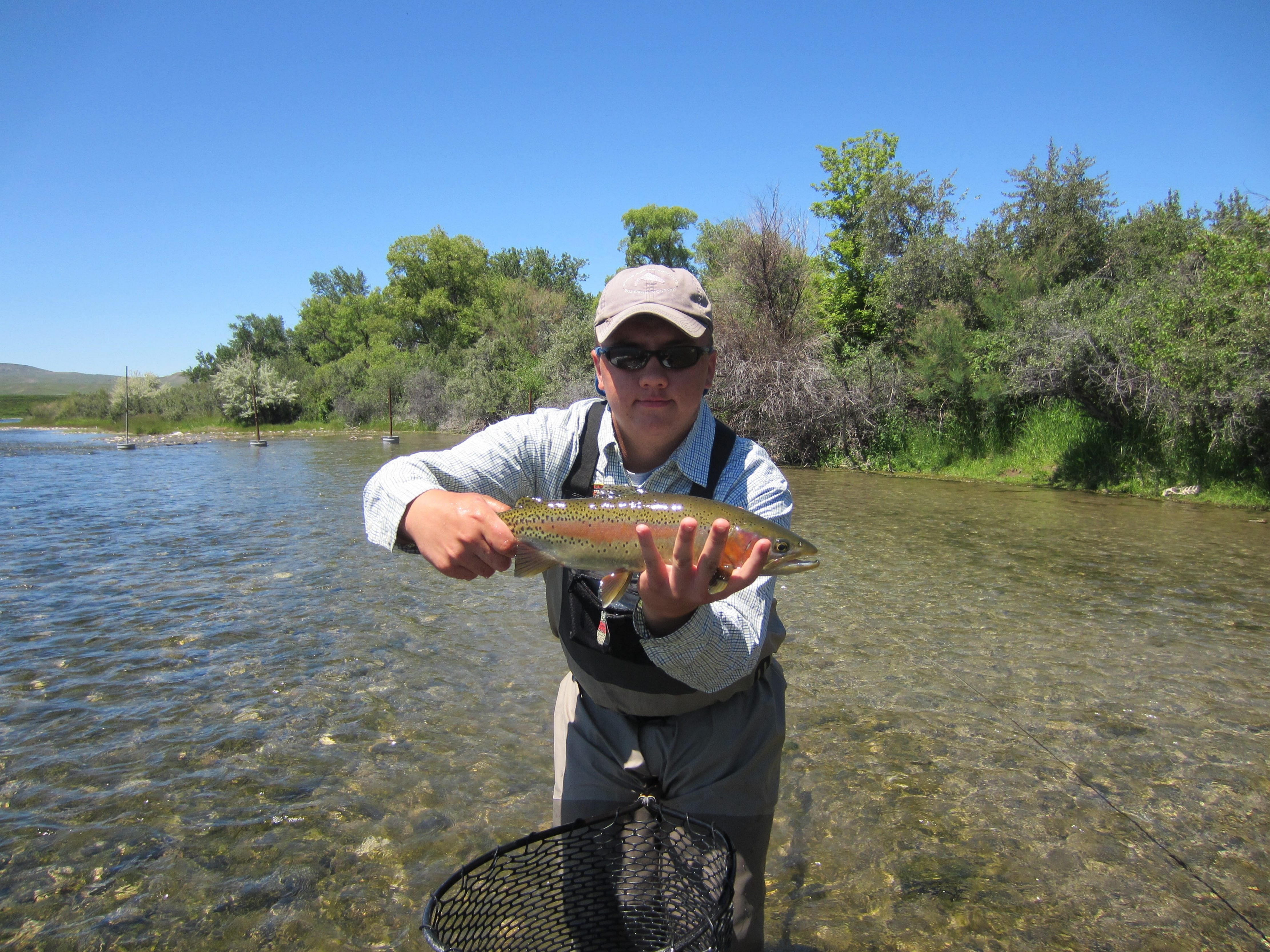 Adam Slavinski with a nice rainbow trout that went for a fly in Montana's Bighorn River.