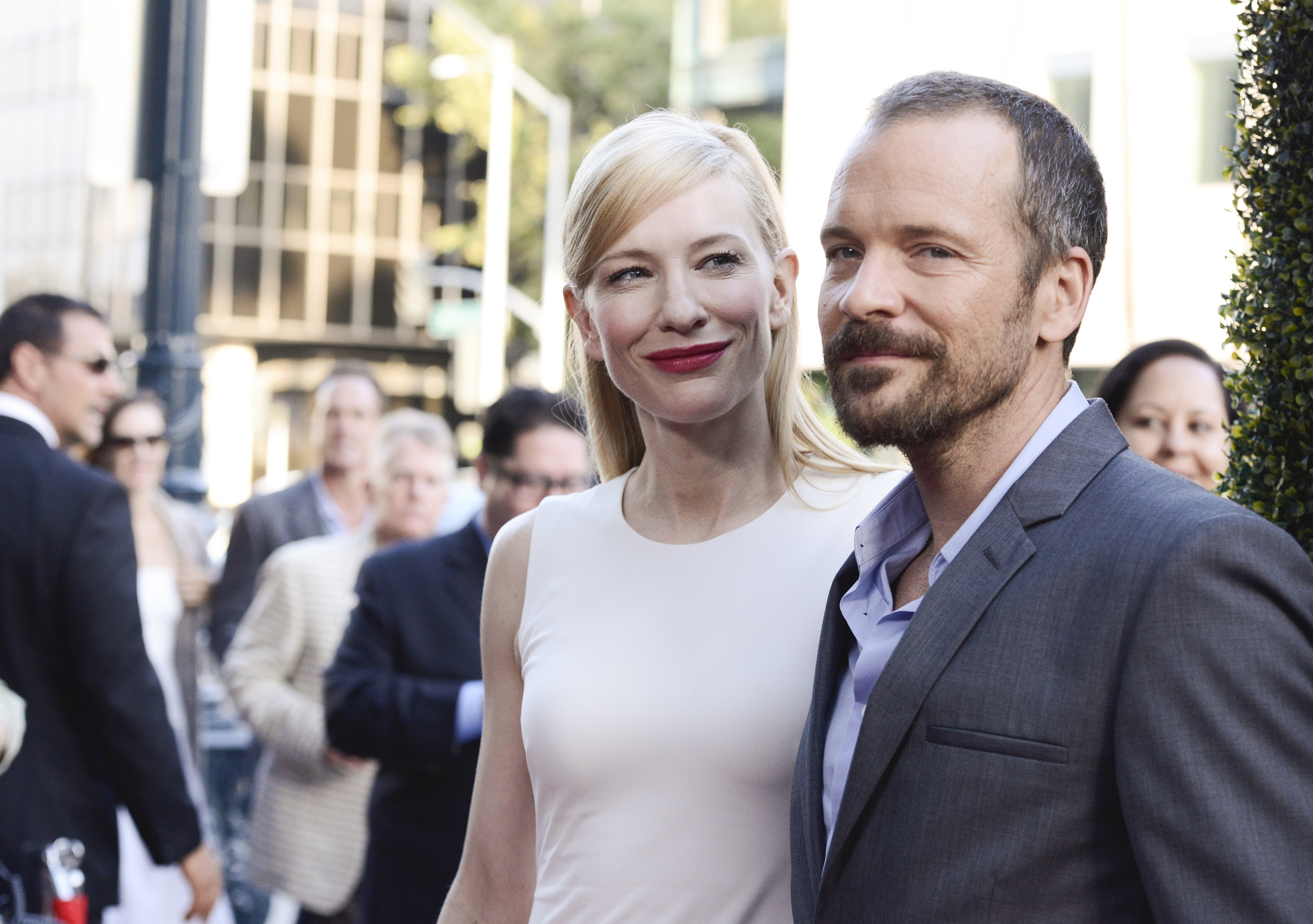 """Something to smile about: Actors Cate Blanchett and Peter Sarsgaard are all smiles as they arrive at the Los Angeles premiere of """"Blue Jasmine"""" on Wednesday."""