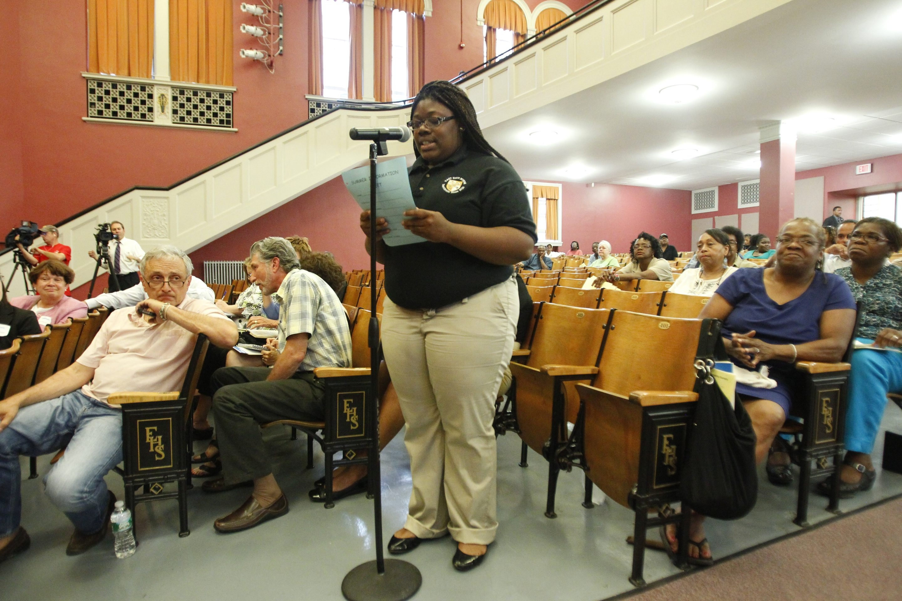 Teresa Hall, a 2011 graduate of East, speaks at the high school in community meeting where district officials explained options on Monday.  Harry Scull Jr./Buffalo News