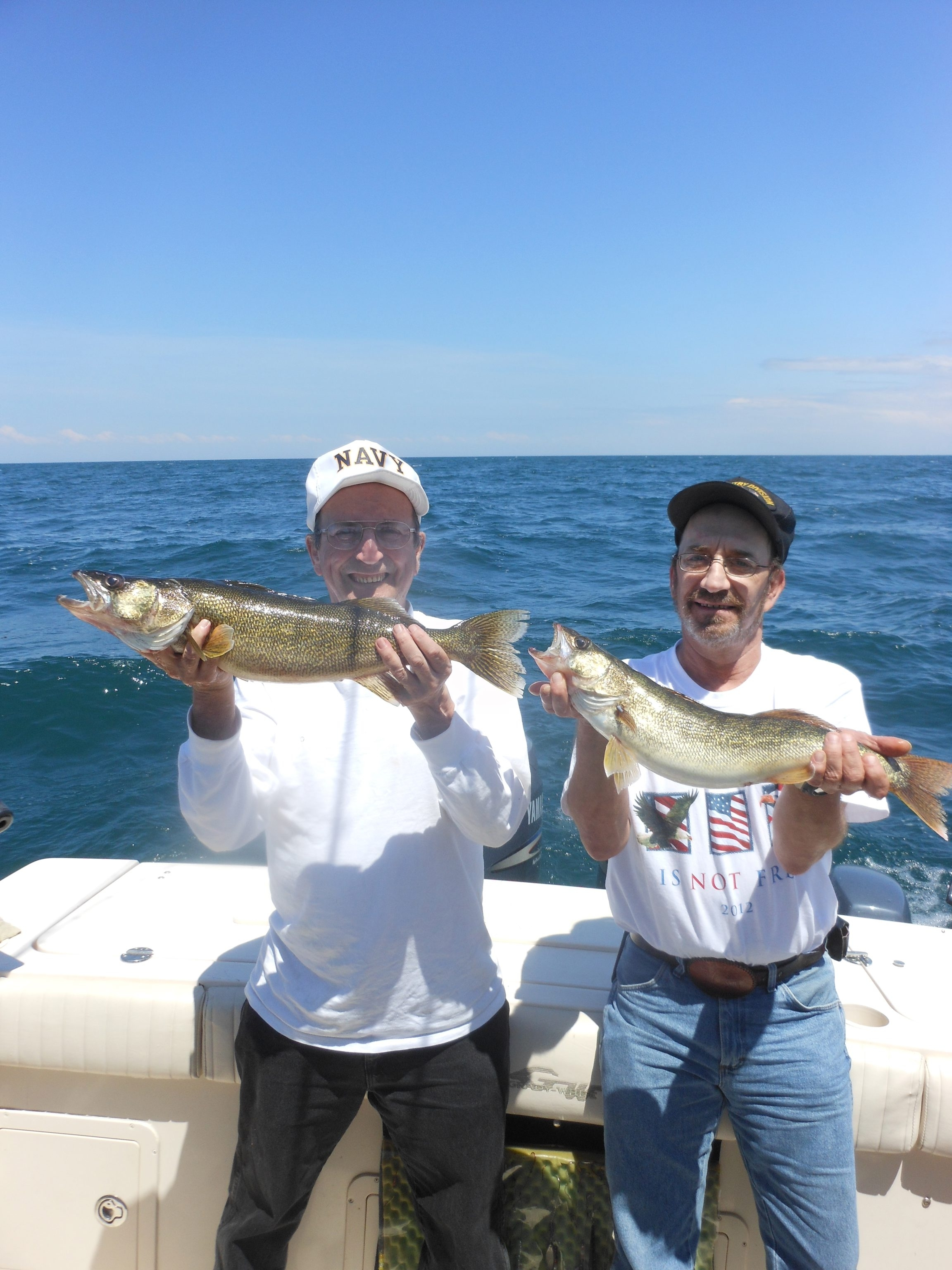 Veterans Dwight Wiebold and Vince Niedzielski from Erie, Pa. with a pair of nice Lake Erie walleye from waters off Barcelona Harbor.