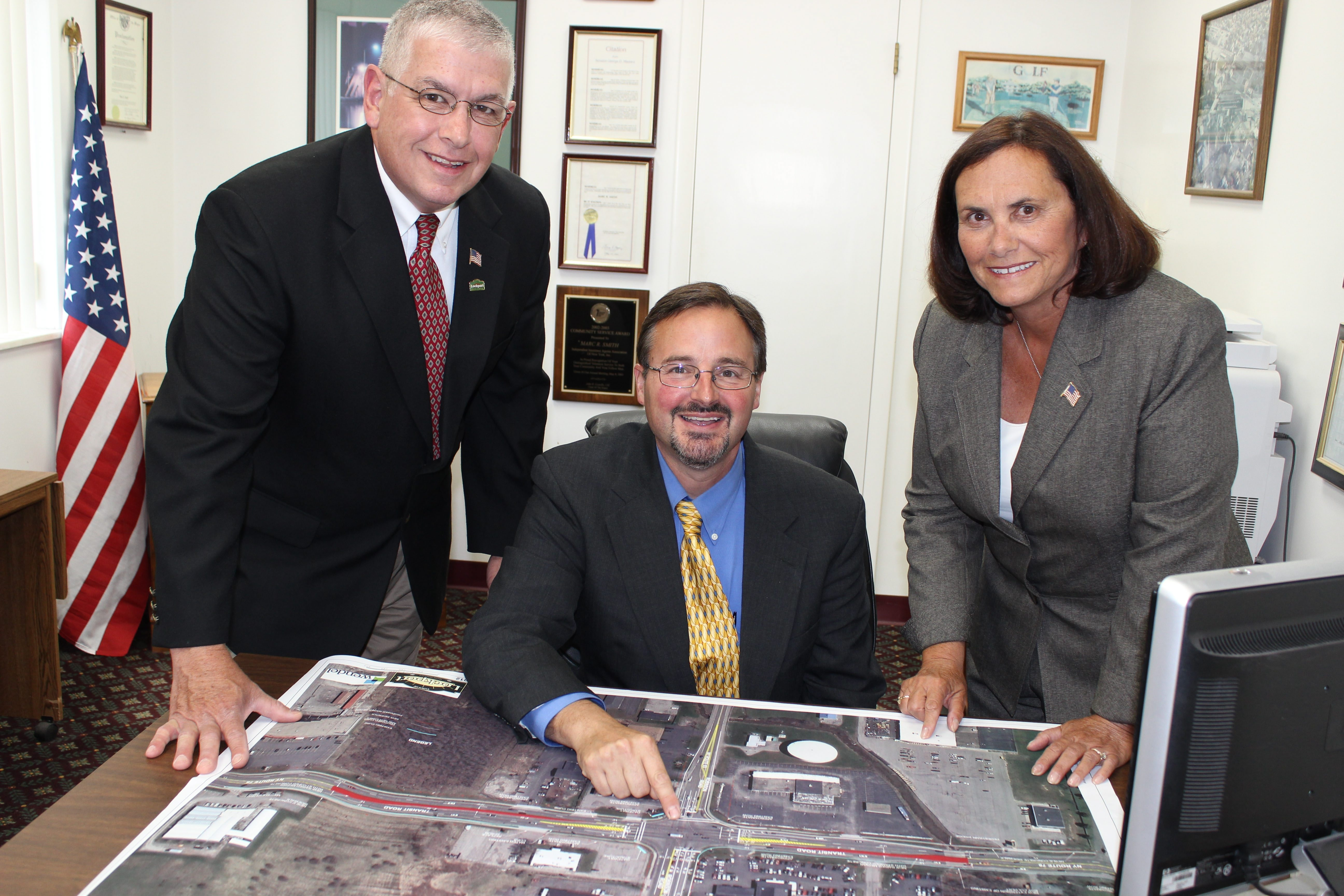 From left, Deputy Supervisor Mark Crocker, Supervisor Marc Smith and Councilwoman Pat DuFour display a map of the Transit North corridor, where the town is trying to boost business and, thus, sales tax revenue.