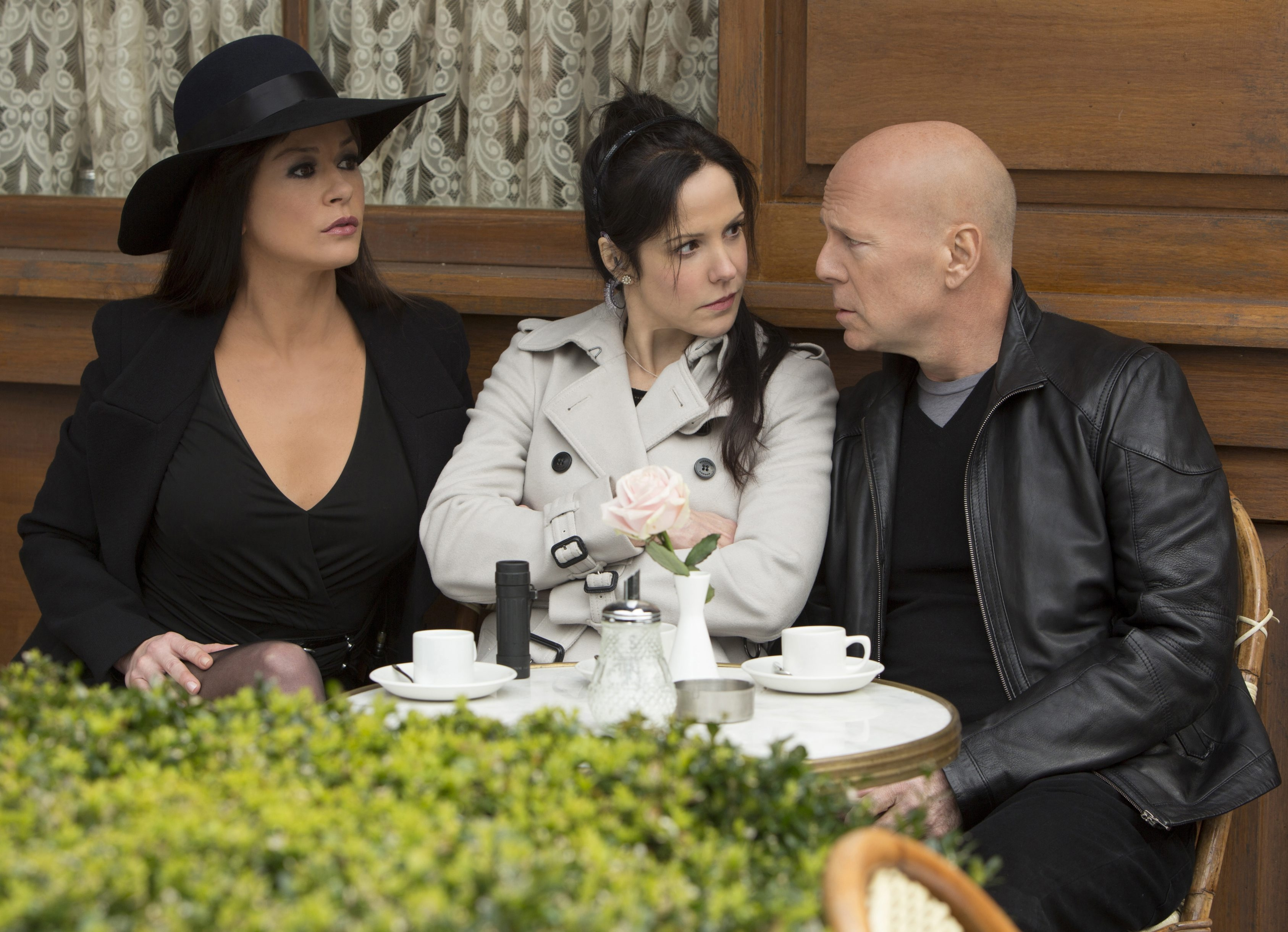 From left, Catherinze Zeta-Jones, Mary-Louise Parker and Bruce Willis star in 'Red 2.'