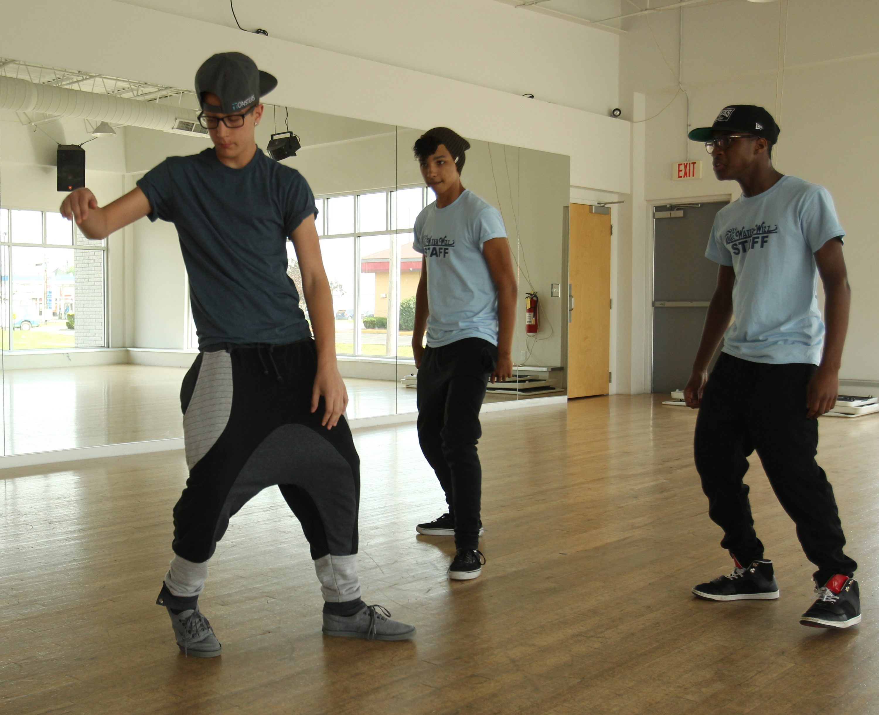 At top, a collection of moves by Tiley Strowzewski. Above, from left, Zach Weaver, Strowzewski and Xavier Drayton at a practice session at Future Dance Center.