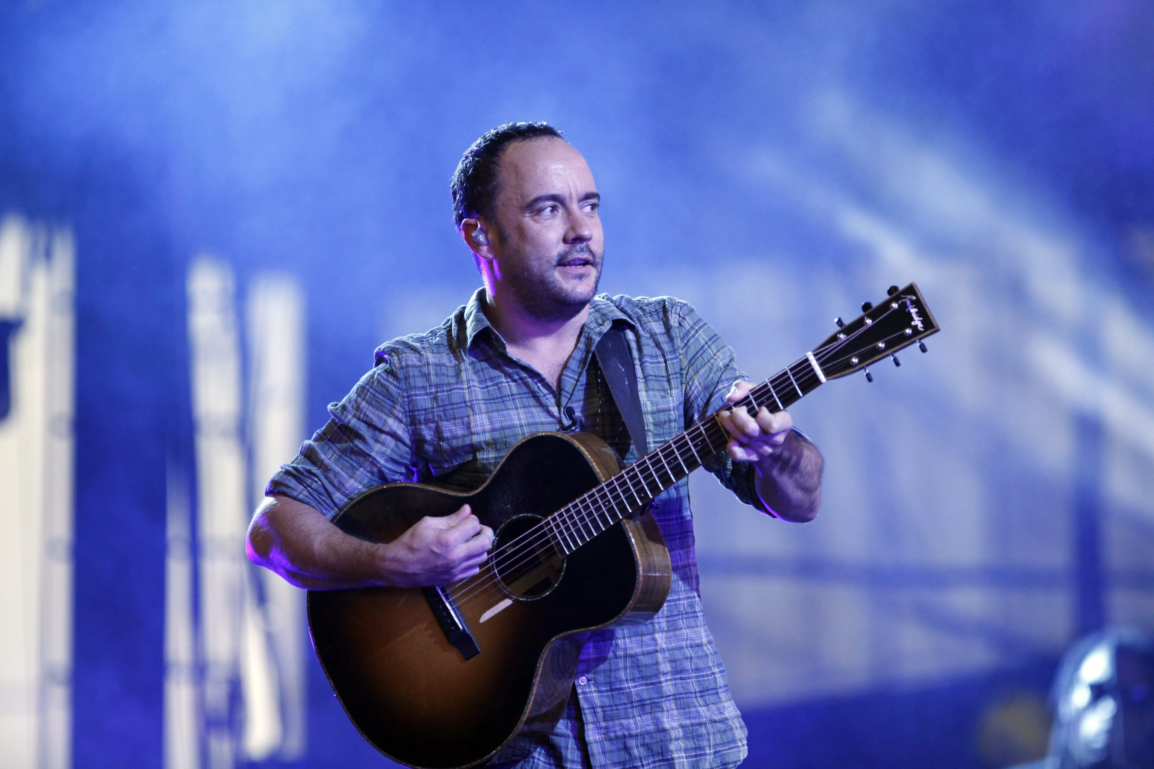 Dave Matthews plays guitar and sings during his band's show at Darien Lake Performing Arts Center. The band dipped into its deep archive, offering pop tunes, folk balladry and radio-friendly anthems.