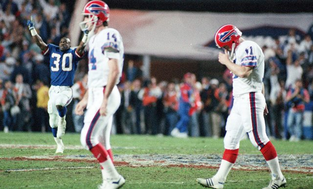 Scott Norwood, right, after missing the 47-yard field goal,  with four seconds left, preserving the Giants' 20-19 victory in Super Bowl XXV in Tampa Stadium. (James P. McCoy/Buffalo News)