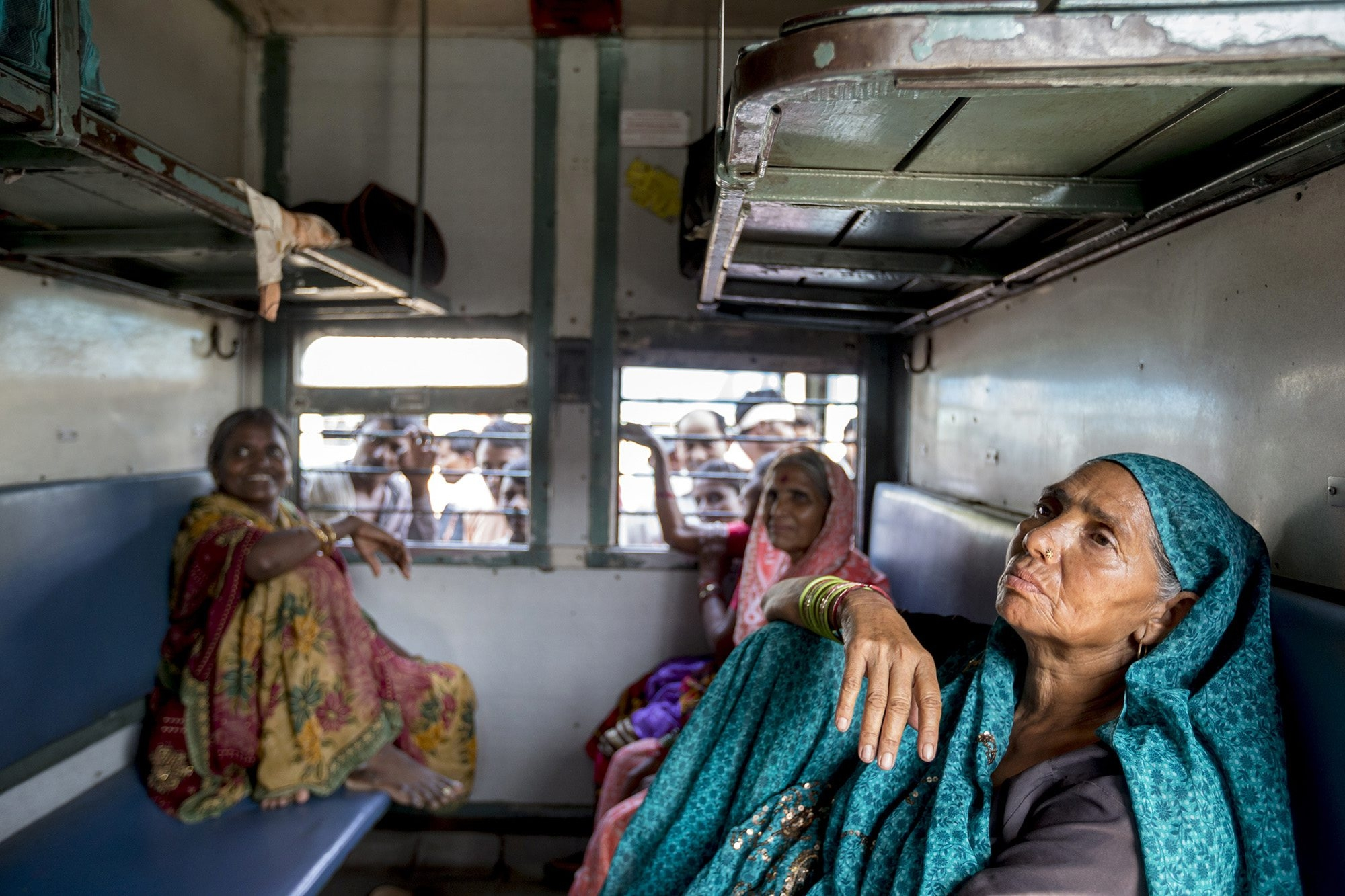Sondi (no last name given, at right) sits with friends from Maharashtra state in a women-only carriage on a train from New Delhi's Nizamuddin Station destined for Gondwana in Vidarbha region of Maharashtra earlier this month.