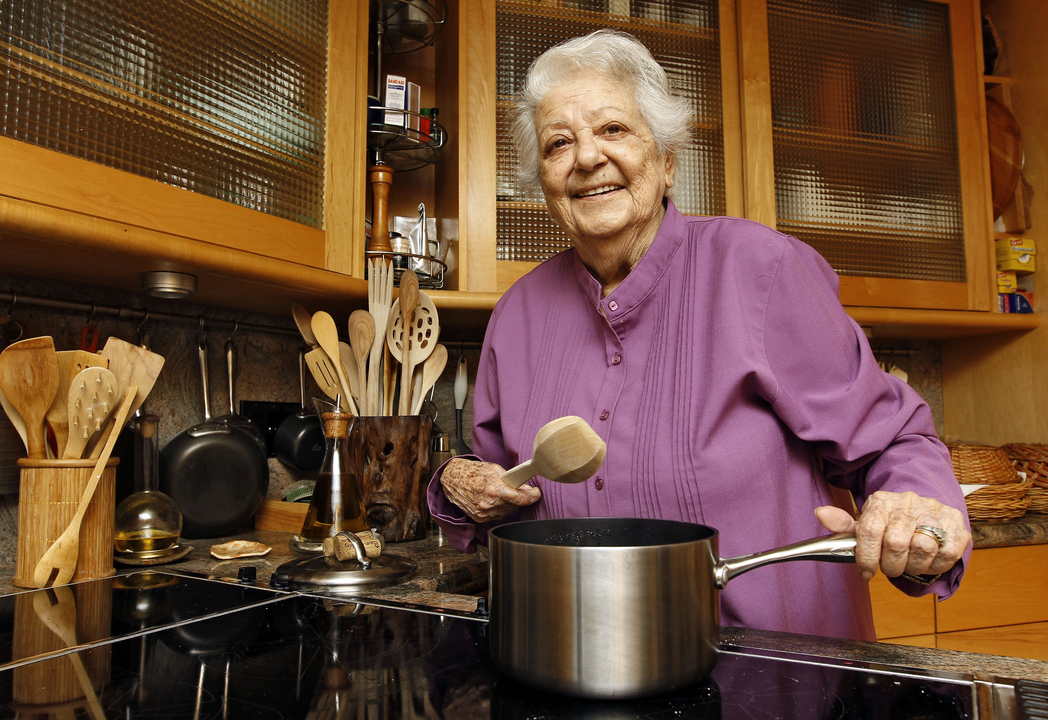 FILE - In this May 29, 2012 file photo, chef Marcella Hazan poses in the kitchen of her Longboat Key, Fla., home. Hazan, the Italian-born cookbook author who taught generations of Americans how to create simple, fresh Italian food, died Sunday, Sept. 30, 2013 at her home in Florida, according to an email from her son, Giuliano Hazan. She was 89.  (AP Photo/Chris O'Meara, File)