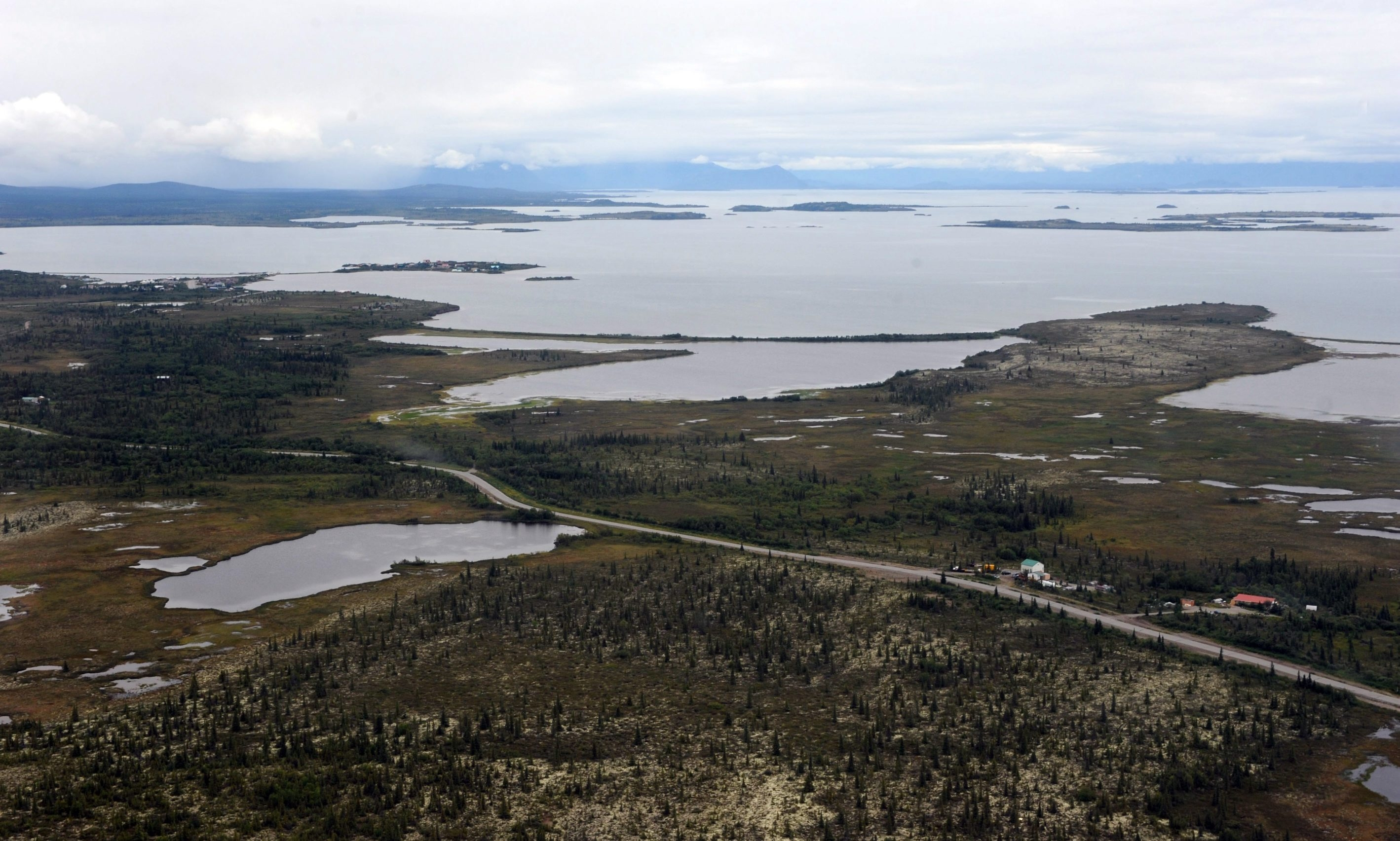 The village of Iliamna, Alaska, is just a small cluster of buildings around crystal-clear Lake Iliamna, a nursery for wild salmon. At 80 miles long, Lake Iliamna is the largest U.S. freshwater lake outside the Great Lakes.