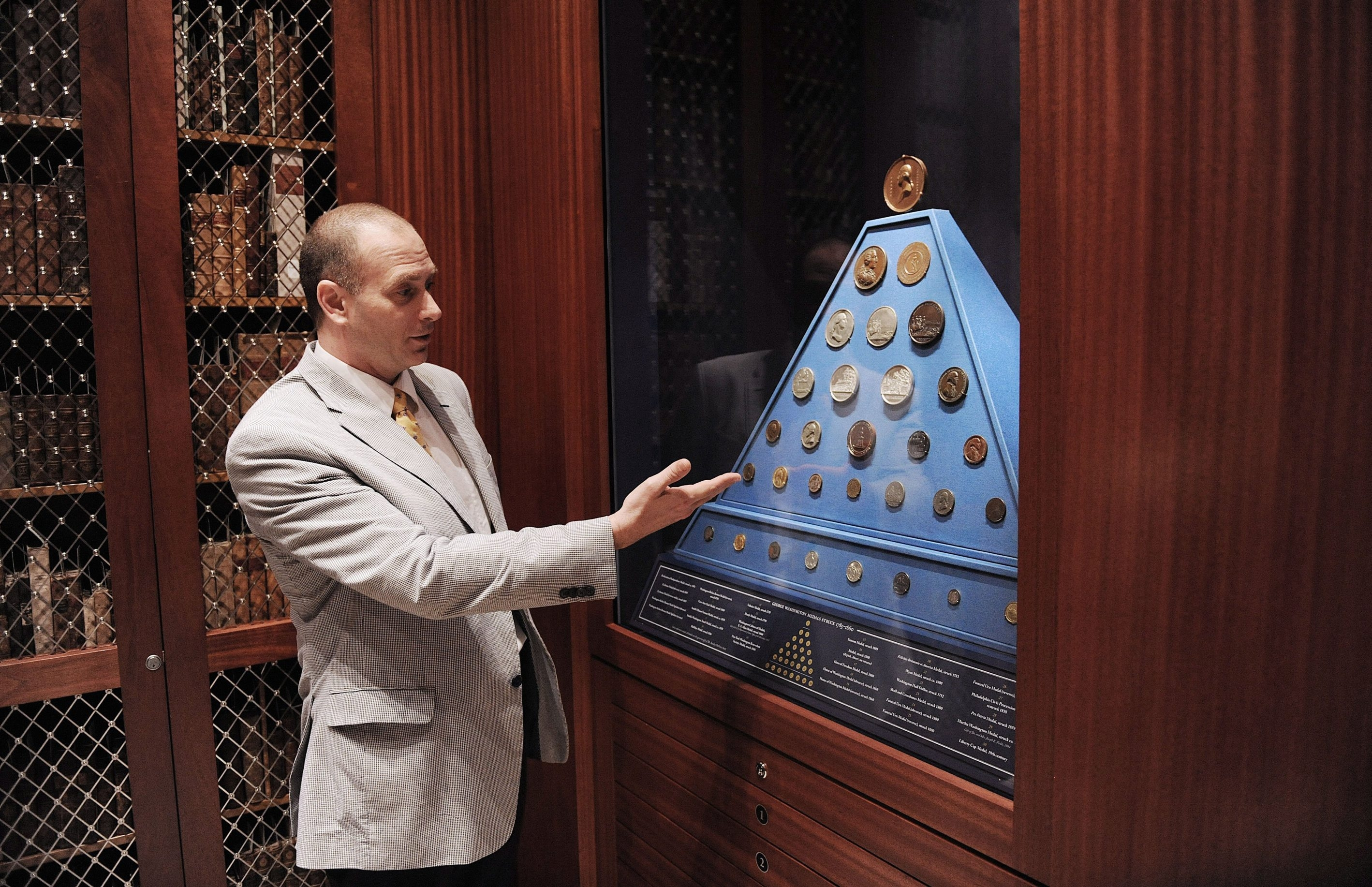 Librarian Mark Santangelo shows Washington's medals at the George Washington Library in Virginia. The facility adds a scholarly element to the understanding of the first president.