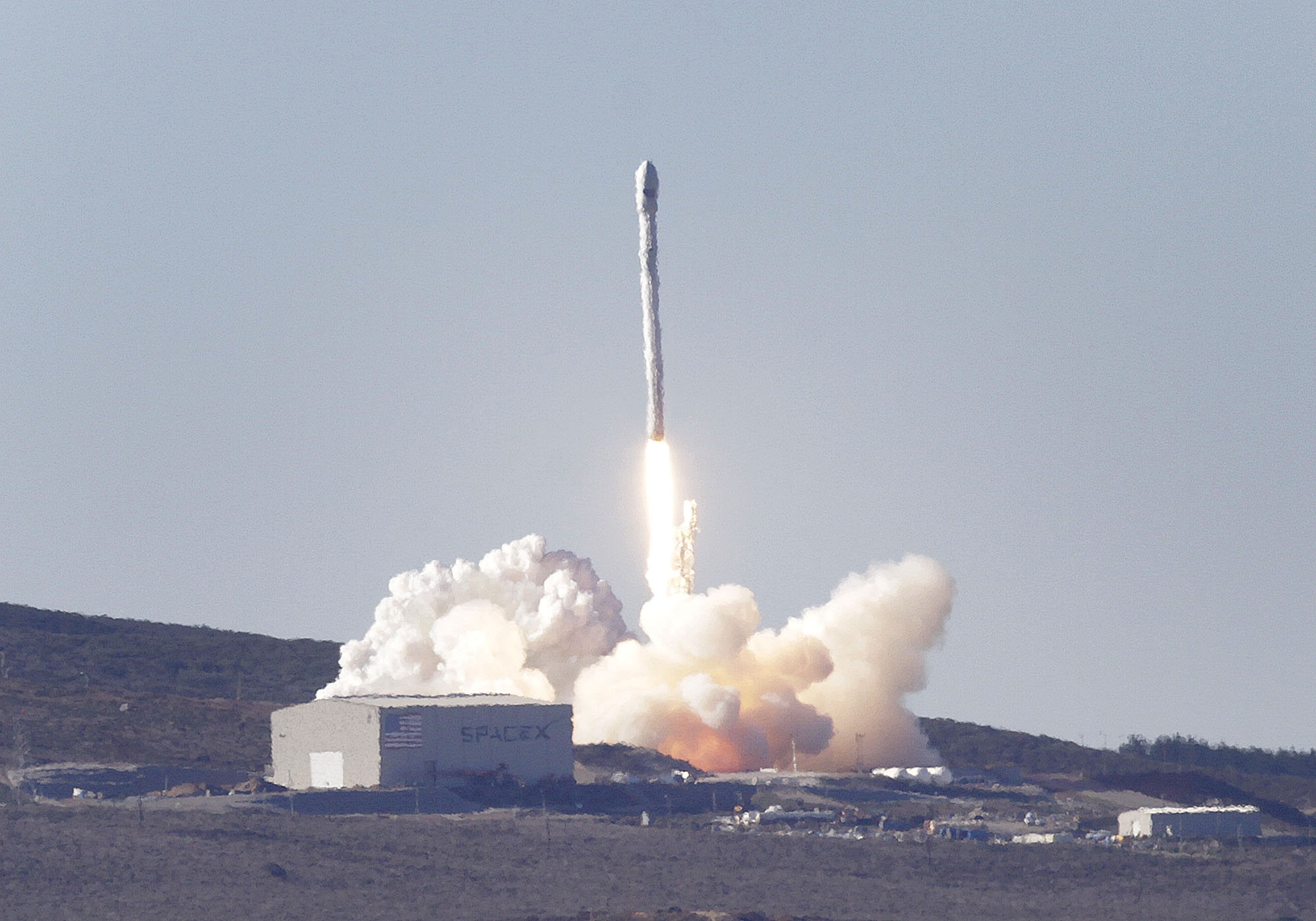 """A SpaceX Falcon 9 rocket blasts off from Vandenberg Air Force Base in California on Sunday. The rocket carried into orbit a small satellite that will study """"space weather."""""""