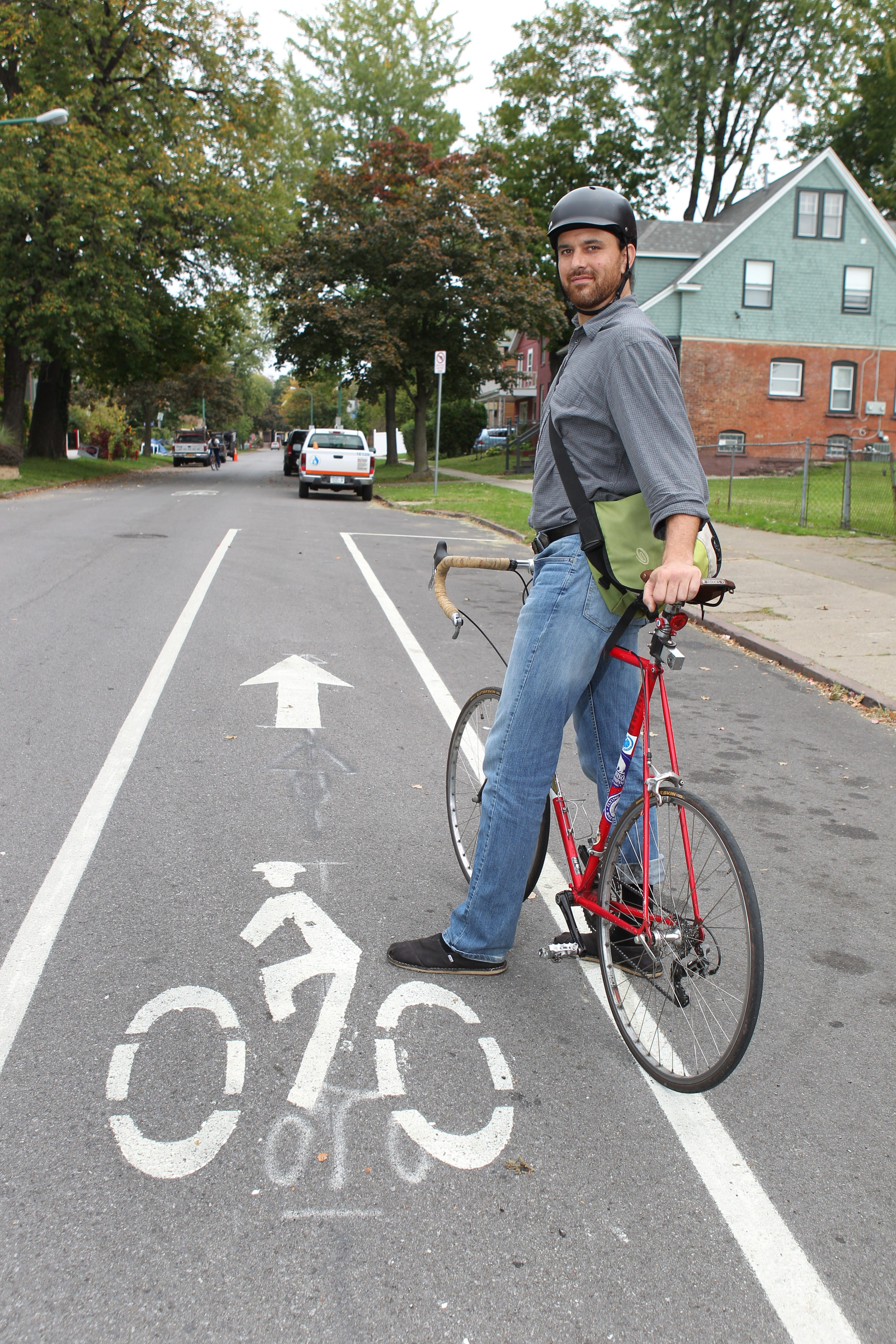 GObike Buffalo Executive Director Justin Booth rarely uses his car. He says he always wears a helmet and clothing that ensures drivers can easily see him.