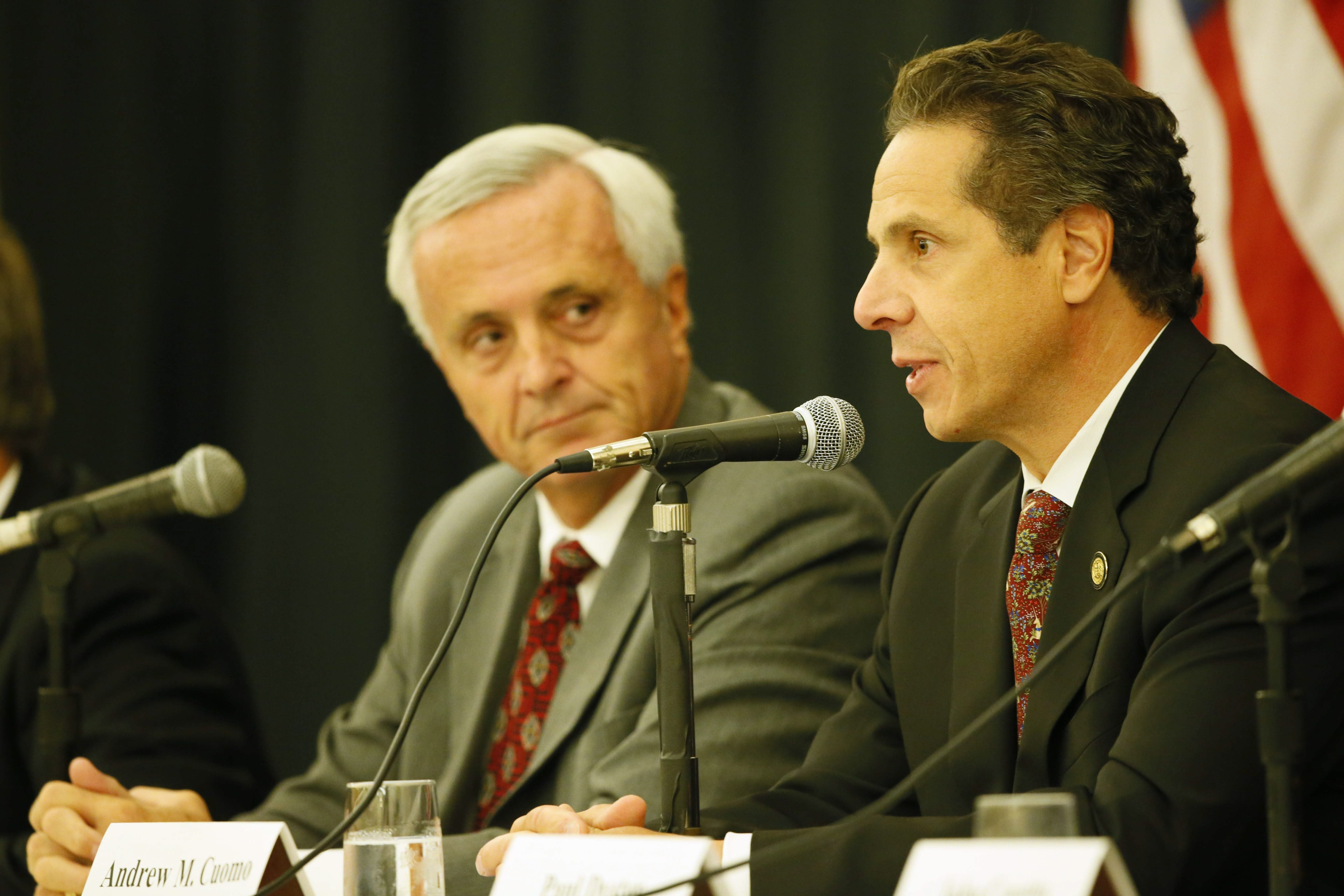 Gov. Andrew M. Cuomo, joined by developer Mark E. Hamister, speaks at news conference announcing an agreement on stalled hotel project in Niagara Falls.