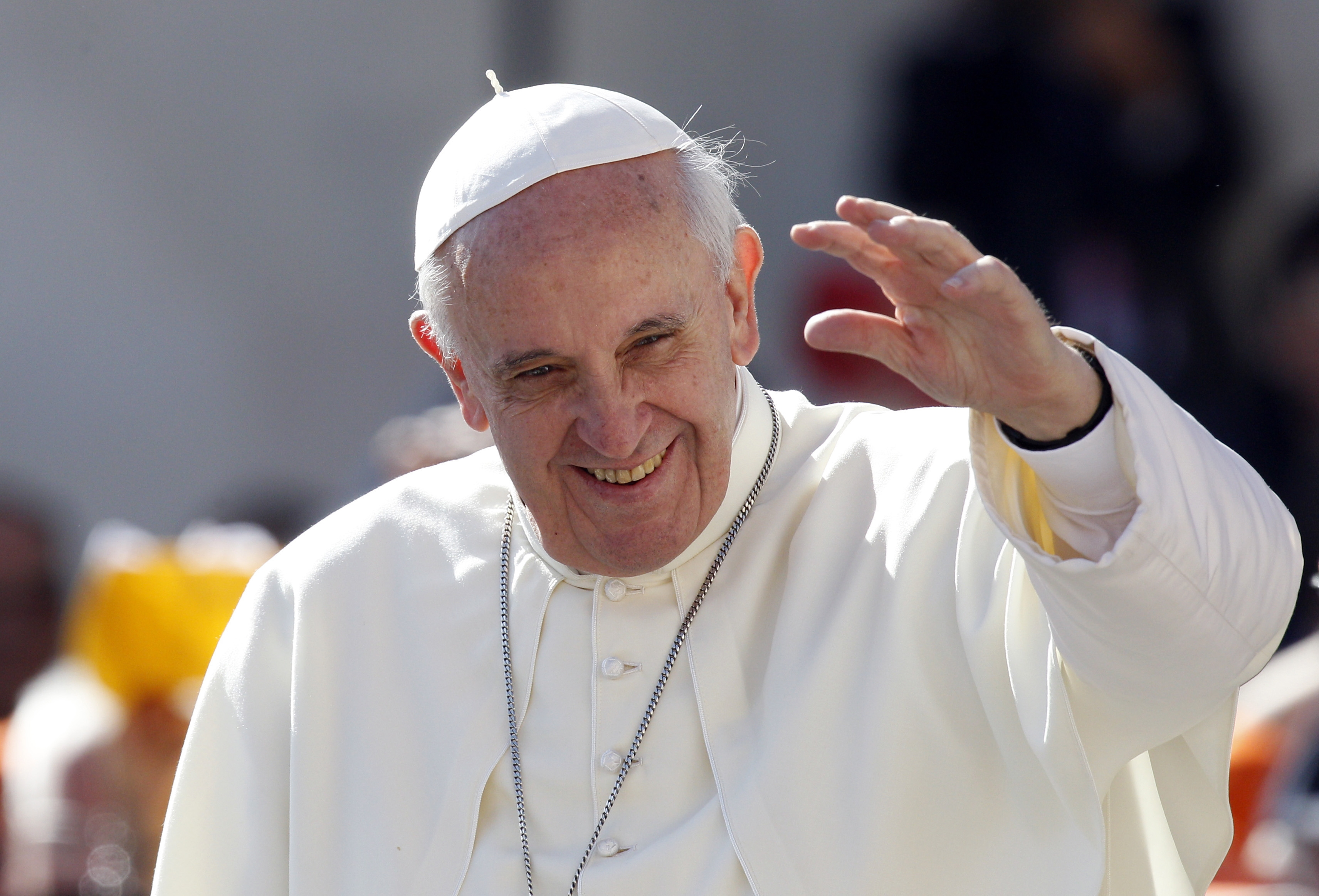 Pope Francis waves to the faithful as he arrives for his weekly general audience Wednesday in St. Peter's Square at the Vatican.