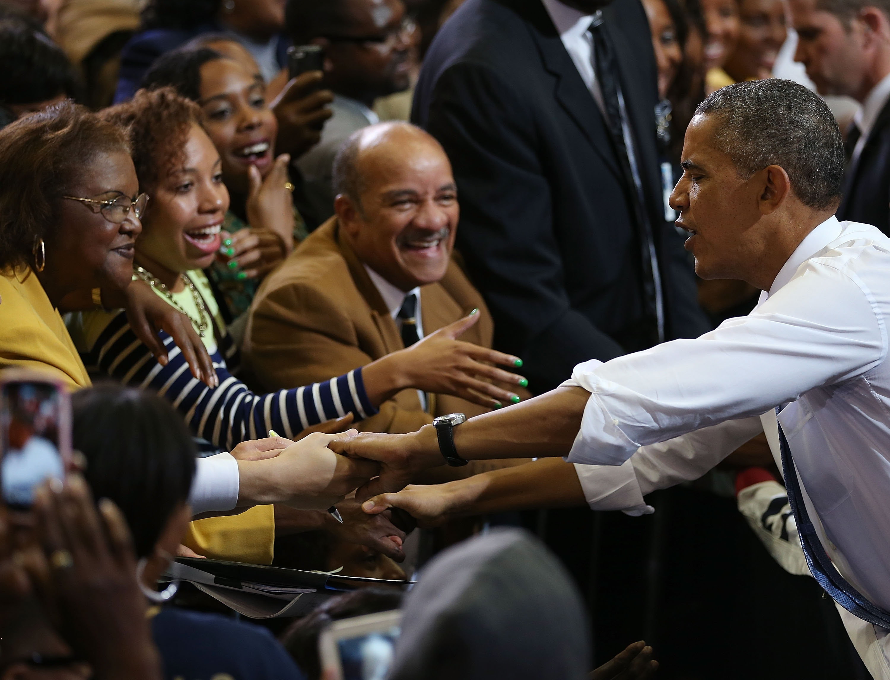 President Obama works the crowd at the Prince Georges Community College outside Washington, D.C., Thursday as he makes his case for the  Affordable Care Act.