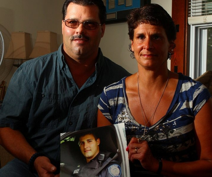 Photo of Frederick Garrasi III, Evans off-duty police officer, is shown by parents Frederick Jr. and Renee at their Angola home. Their son was killed when a car cut off his motorcycle.