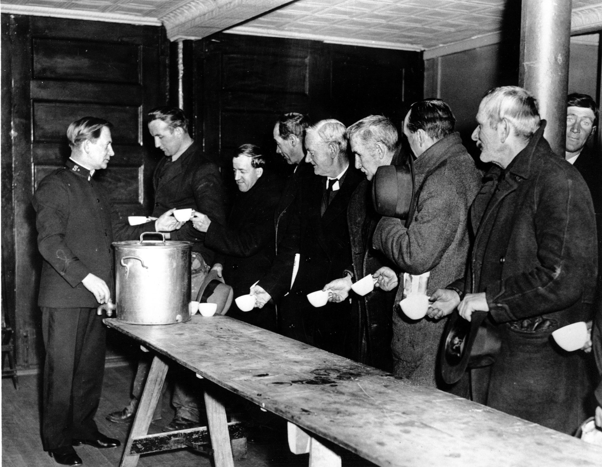 A Salvation Army relief worker tends to a line at a soup kitchen during the Great Depression, when the unemployment rate soared to nearly 20 percent. Many Americans today are still struggling to find jobs.
