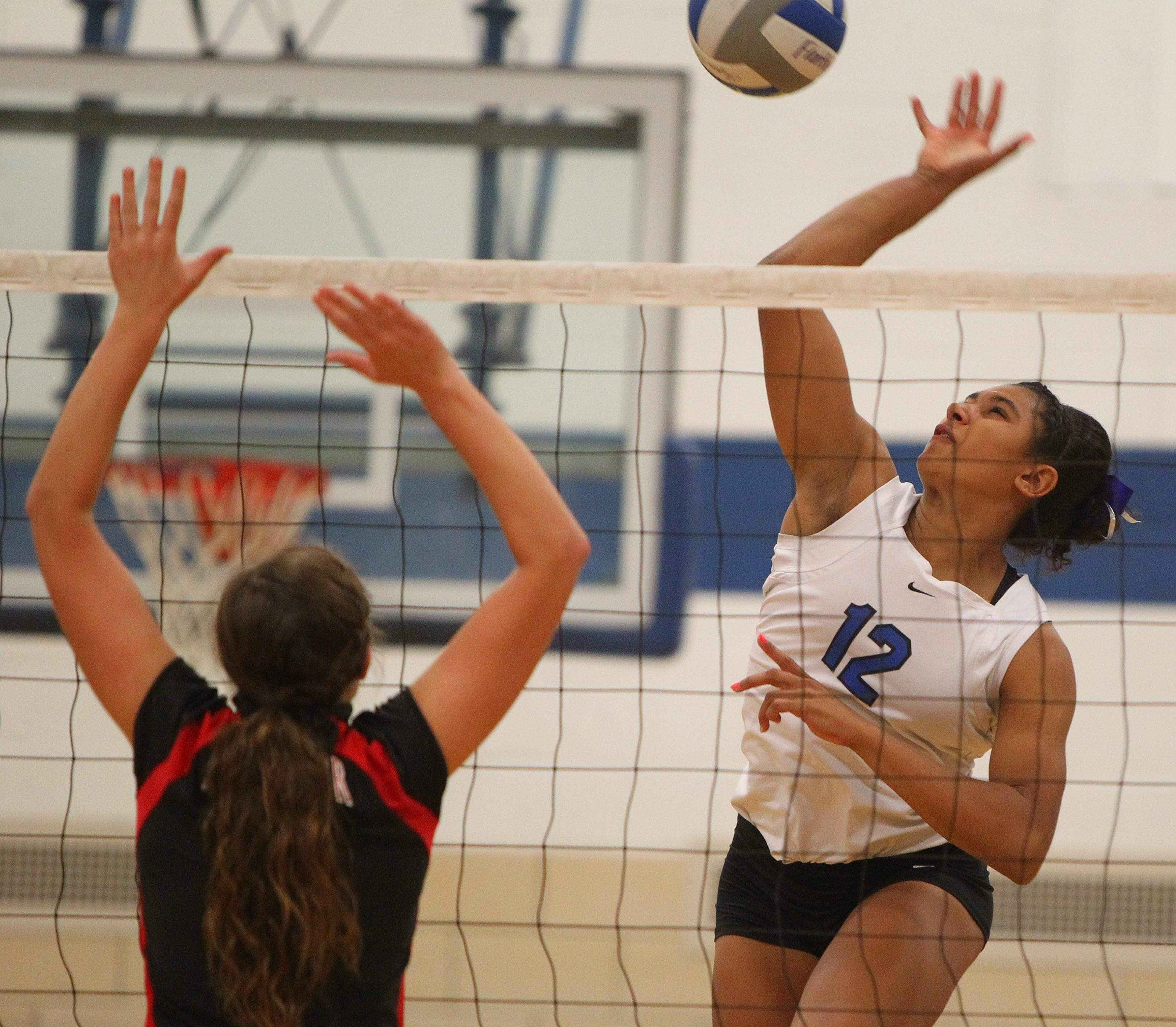 Frontier's McKyla Brooks soars to spike the ball on Lancaster's Emily Ast during a recent match.
