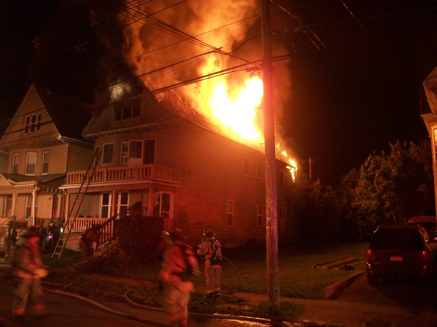 Buffalo firefighters battle a blaze on Riley Street late Sunday.