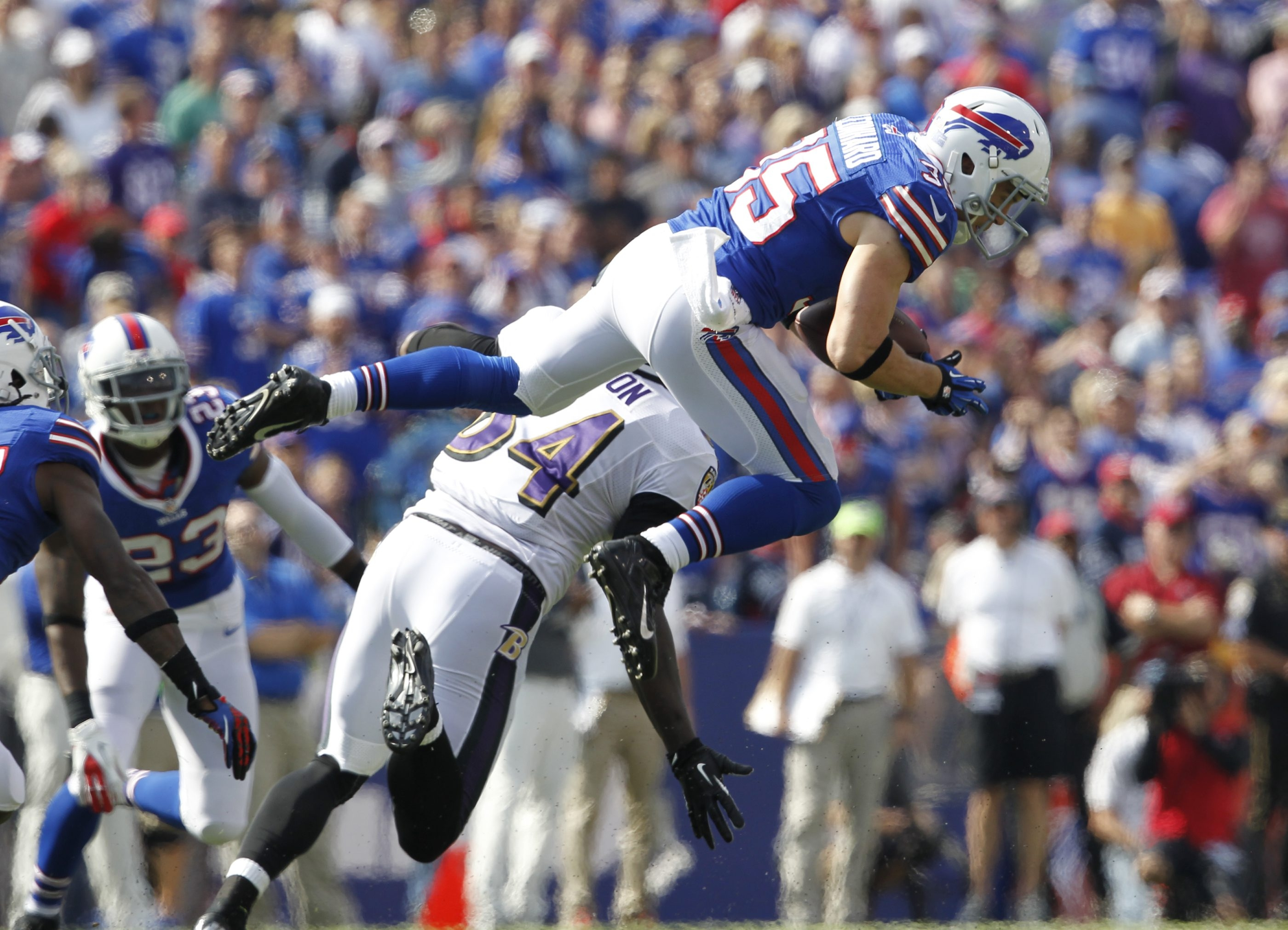 Safety Jim Leonhard comes up with a second-quarter interception, one of five made by the Bills' defense on Sunday against Ravens quarterback Joe Flacco.