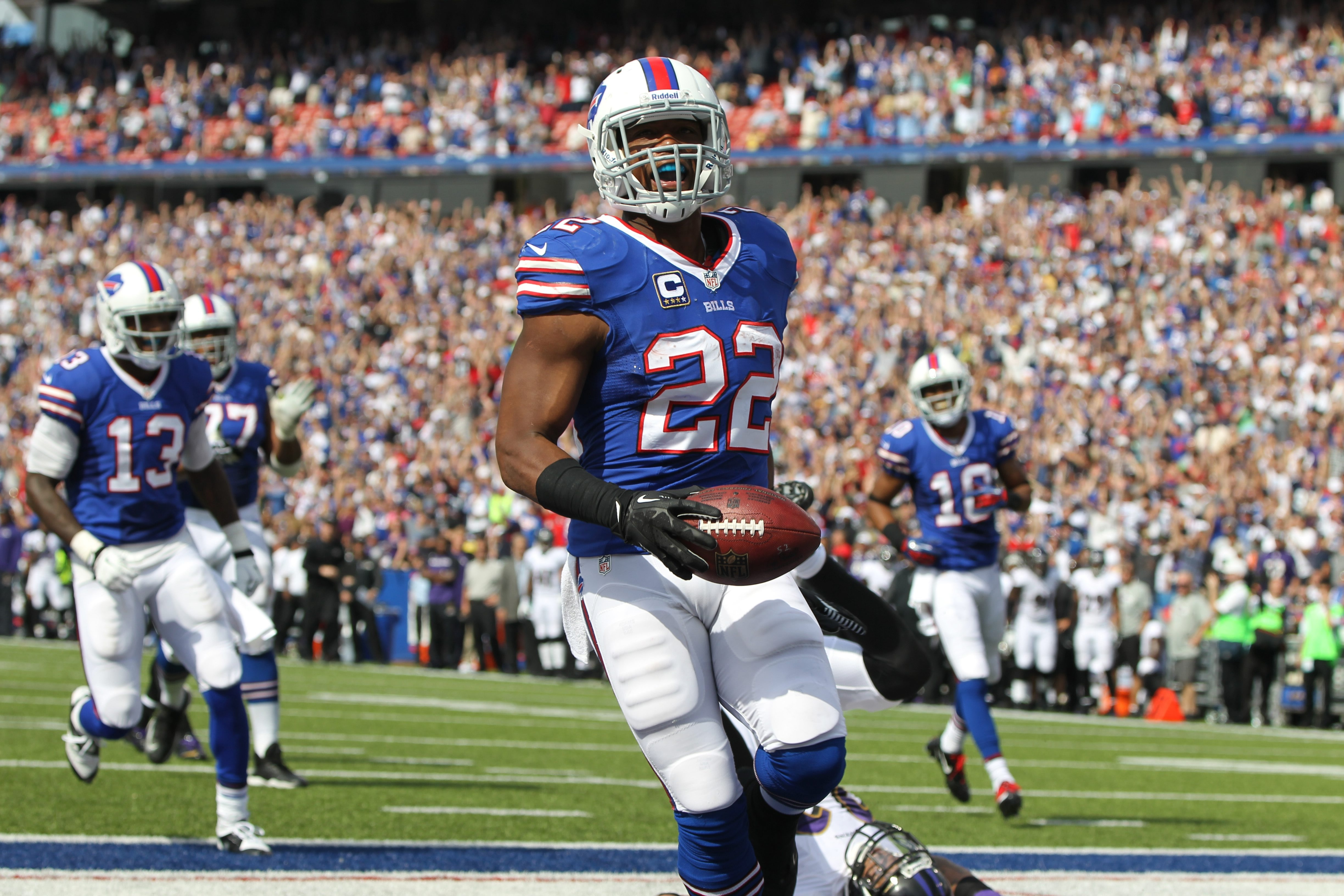 Bills running back Fred Jackson (22) runs for a touchdown over Baltimore Ravens cornerback Jimmy Smith (22) in the second quarter