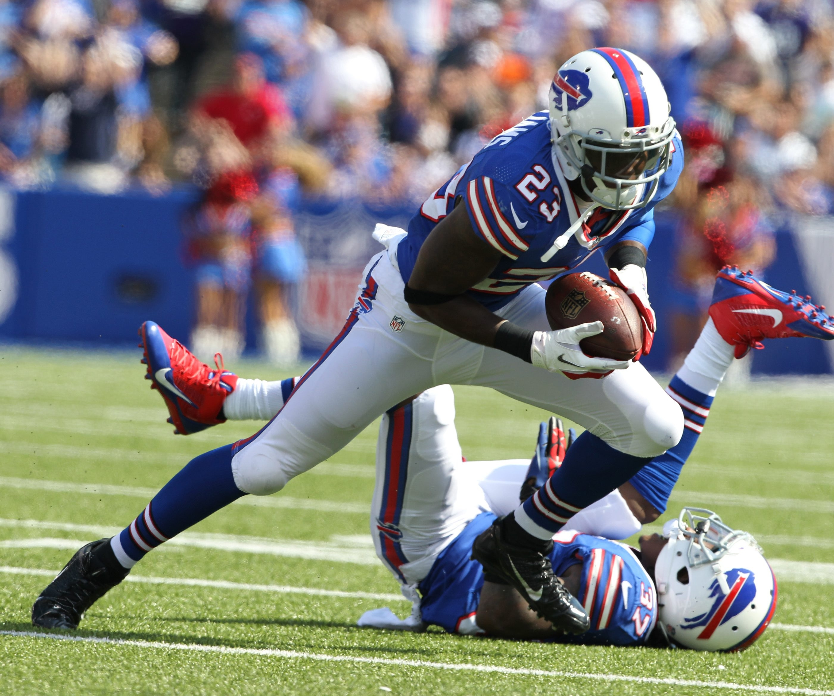Bills cornerback Aaron Williams records one of his two interceptions Sunday. He also got banged up, leaving the game twice in the win.