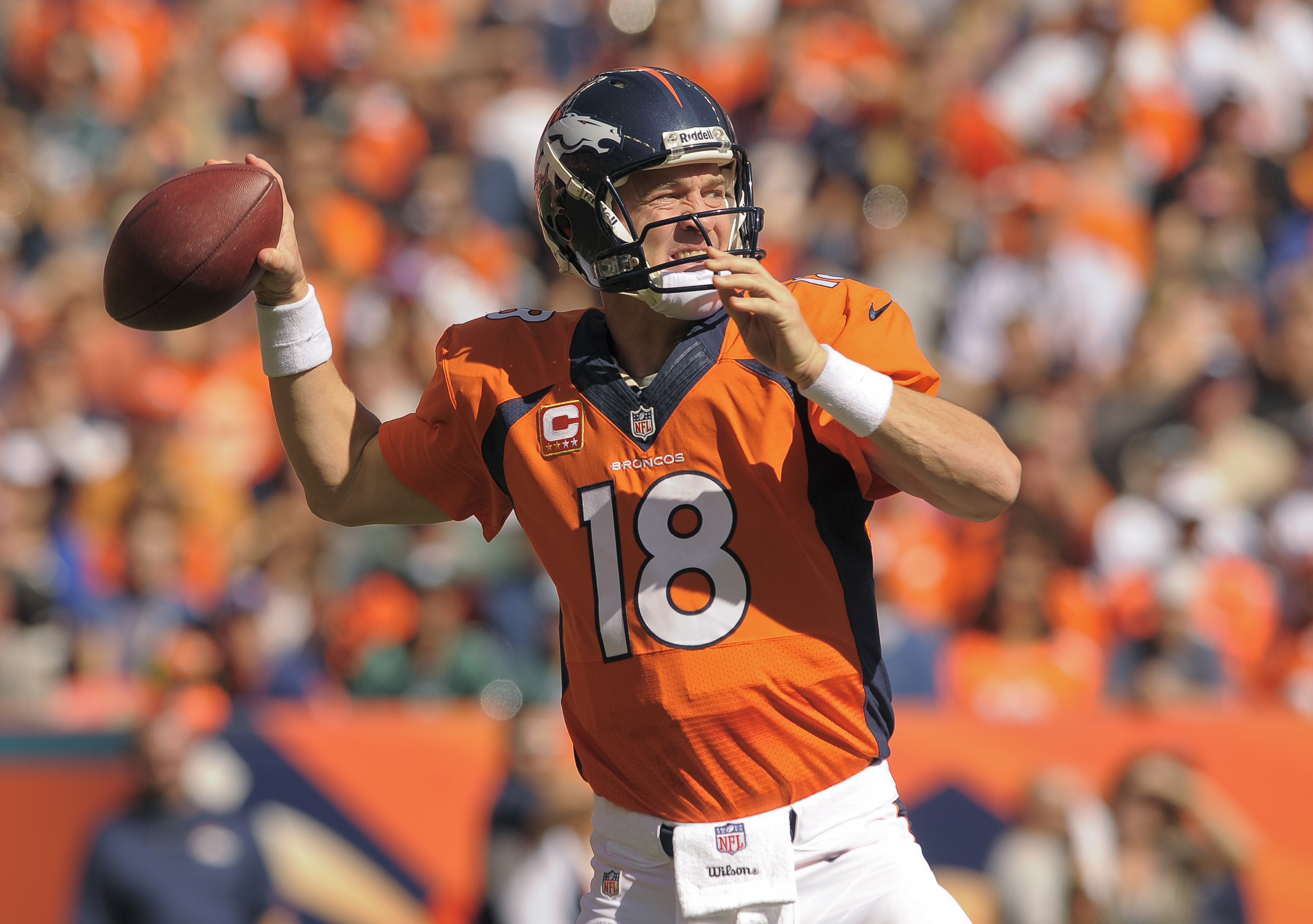 Denver's Peyton Manning set the NFL mark for most touchdown passes (16) during the season's first month and joined Milt Plum as the only quarterbacks in history to throw that many TDs without an interception.