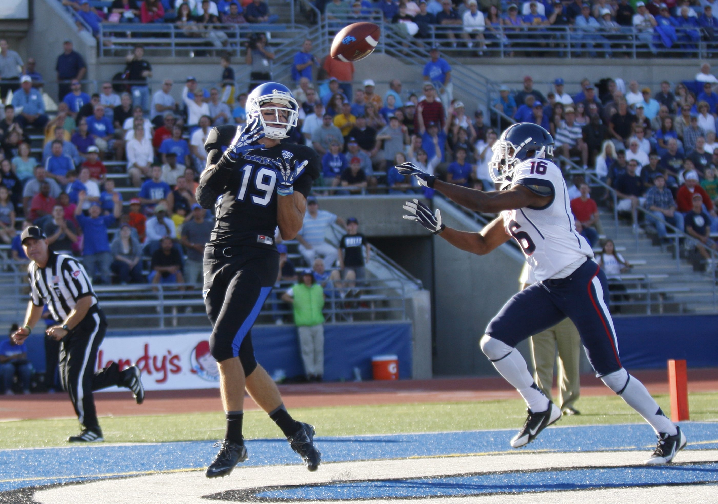 UB's Alex Neutz beats Connecticut defender Bryon Jones for a touchdown in the second quarter Saturday at UB Stadium.