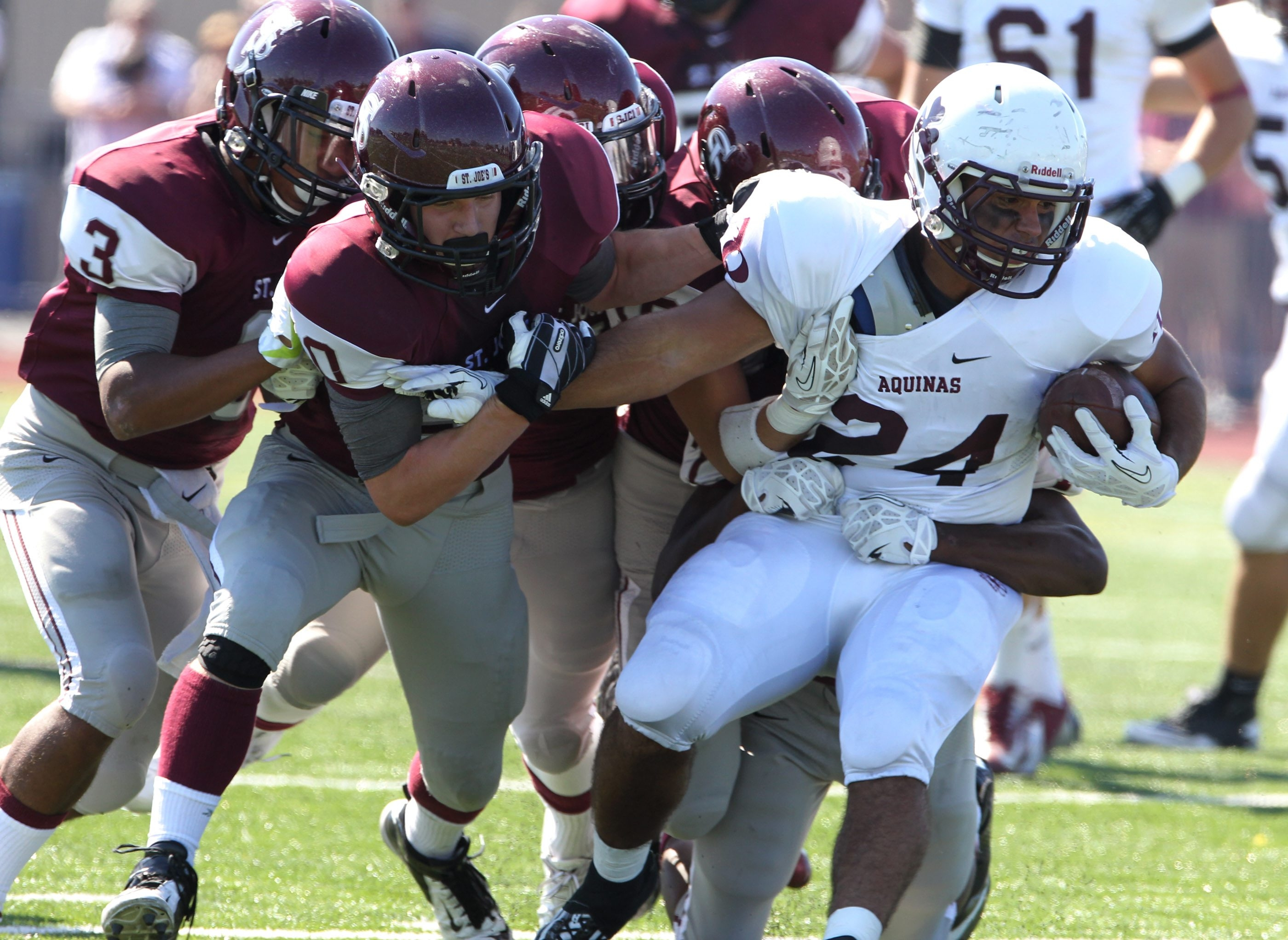 Luch Pietropaolo fights for first-down yardage in the first half for Aquinas, which owns wins over St. Joe's, Canisius and Timon.