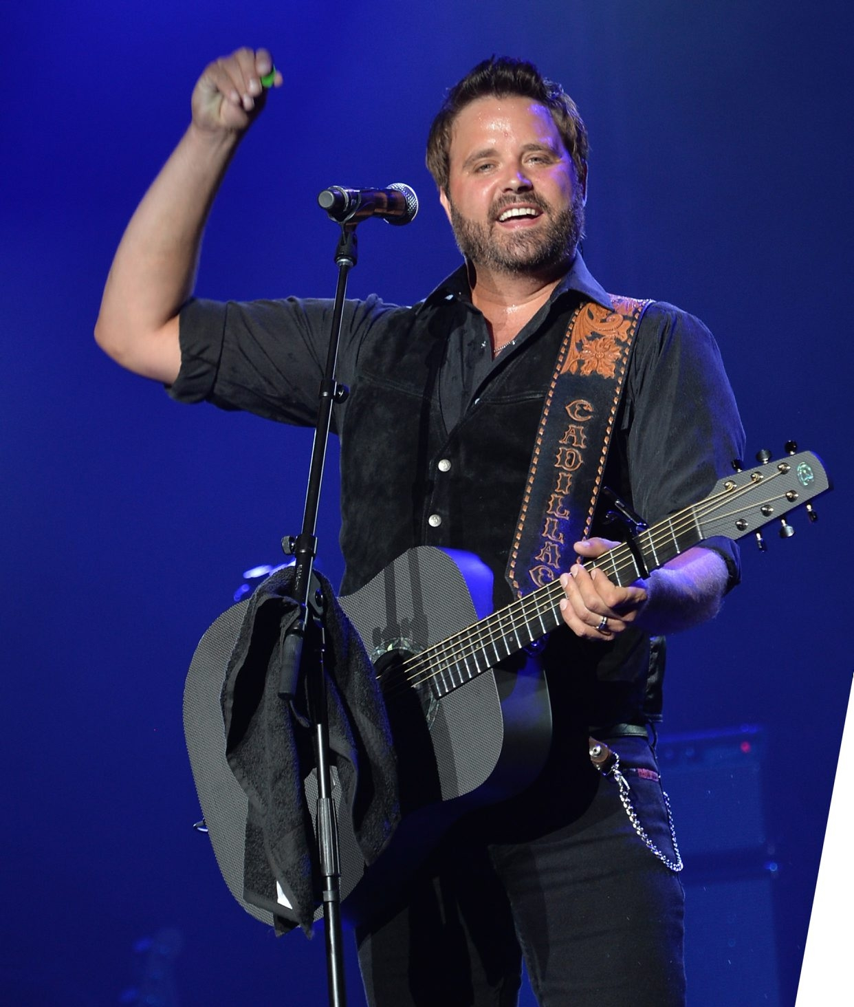 Randy Houser, shown here at a July concert in Prescott, Ariz., performed a trim, hour-long set at UB Saturday.