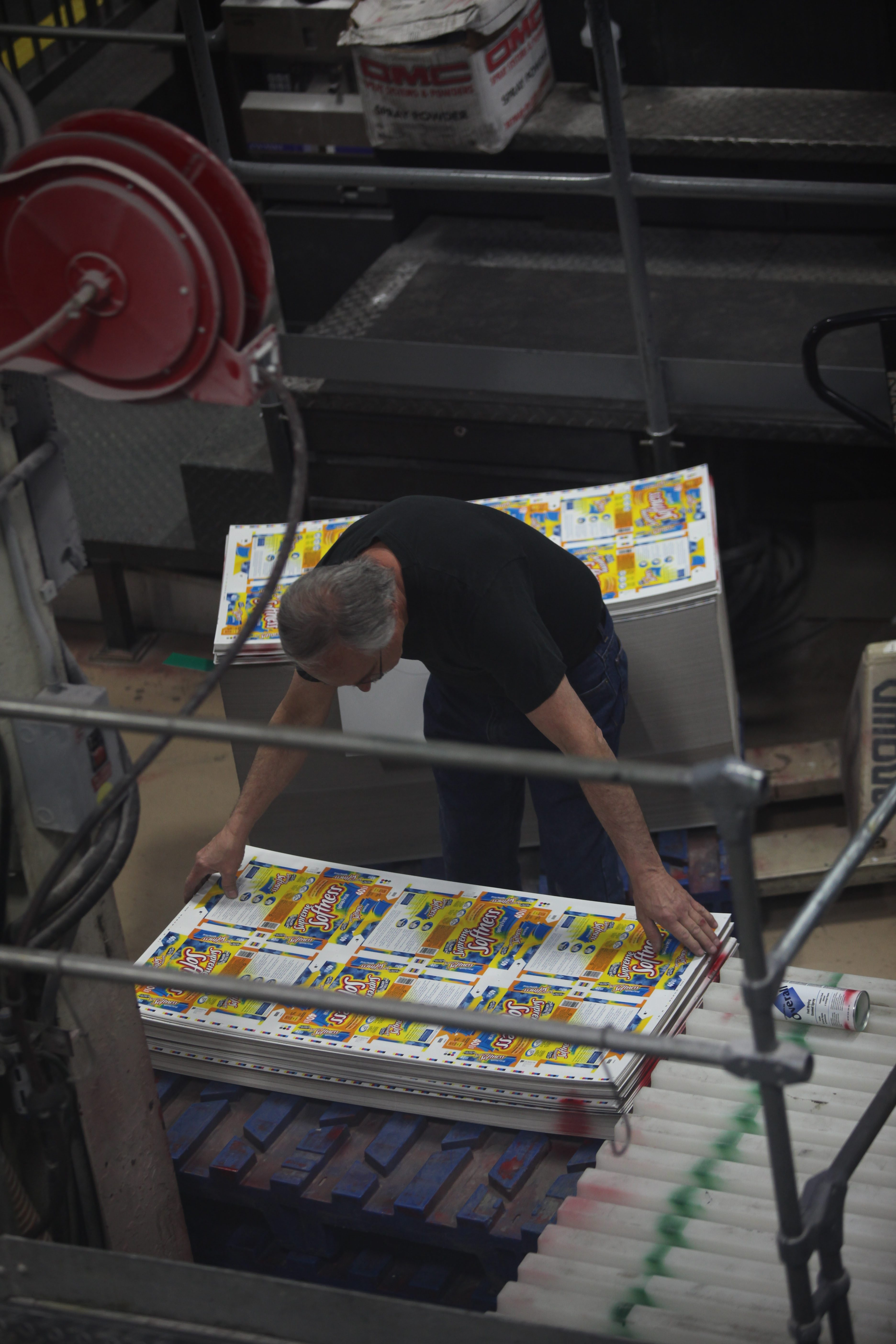 An employee stacks  printed sheets at Mod-Pac in Buffalo. Shareholders have voted to sell the specialty printer to two company executives.