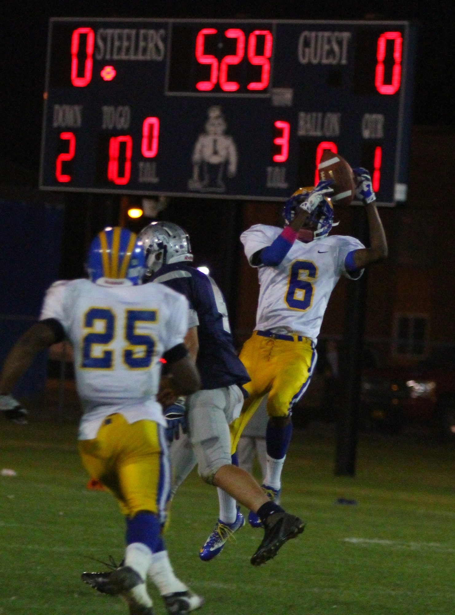 Cleveland Hill's Jared Watkins (6) intercepts a ball and returns it for a TD against Lackawanna on Friday night.