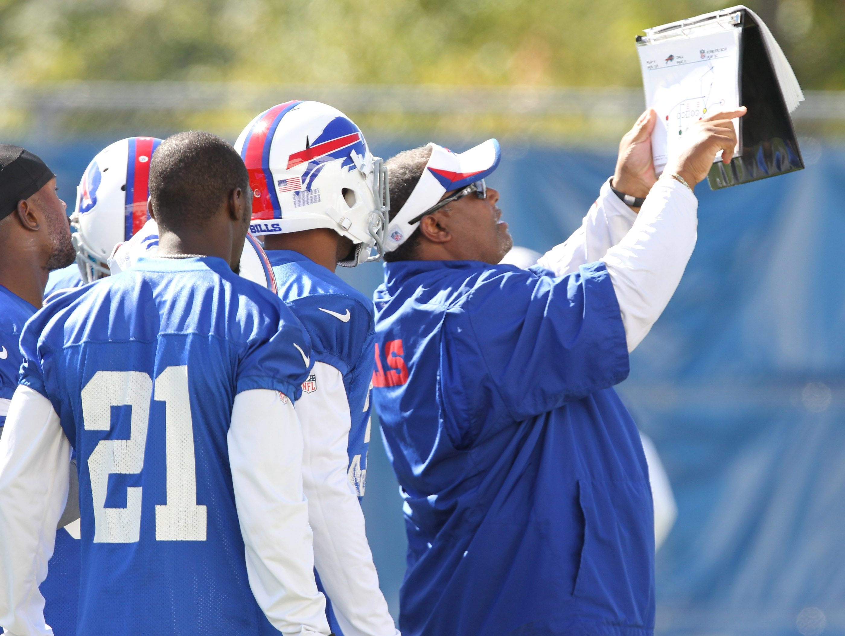 Defensive backs coach Donnie Henderson sticks to the point when working with his players.