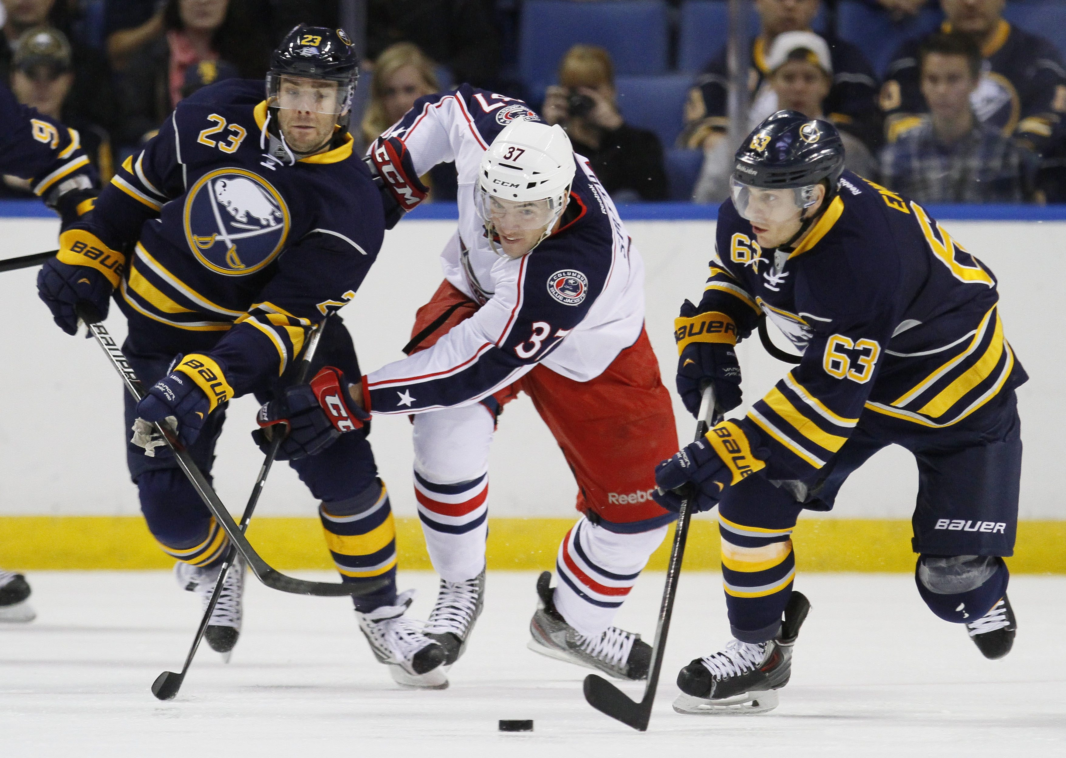 Buffalo's Tyler Ennis, right, and Ville Leino head up ice past Columbus' Dalton Smith during Wednesday night's 3-0 Sabres win.