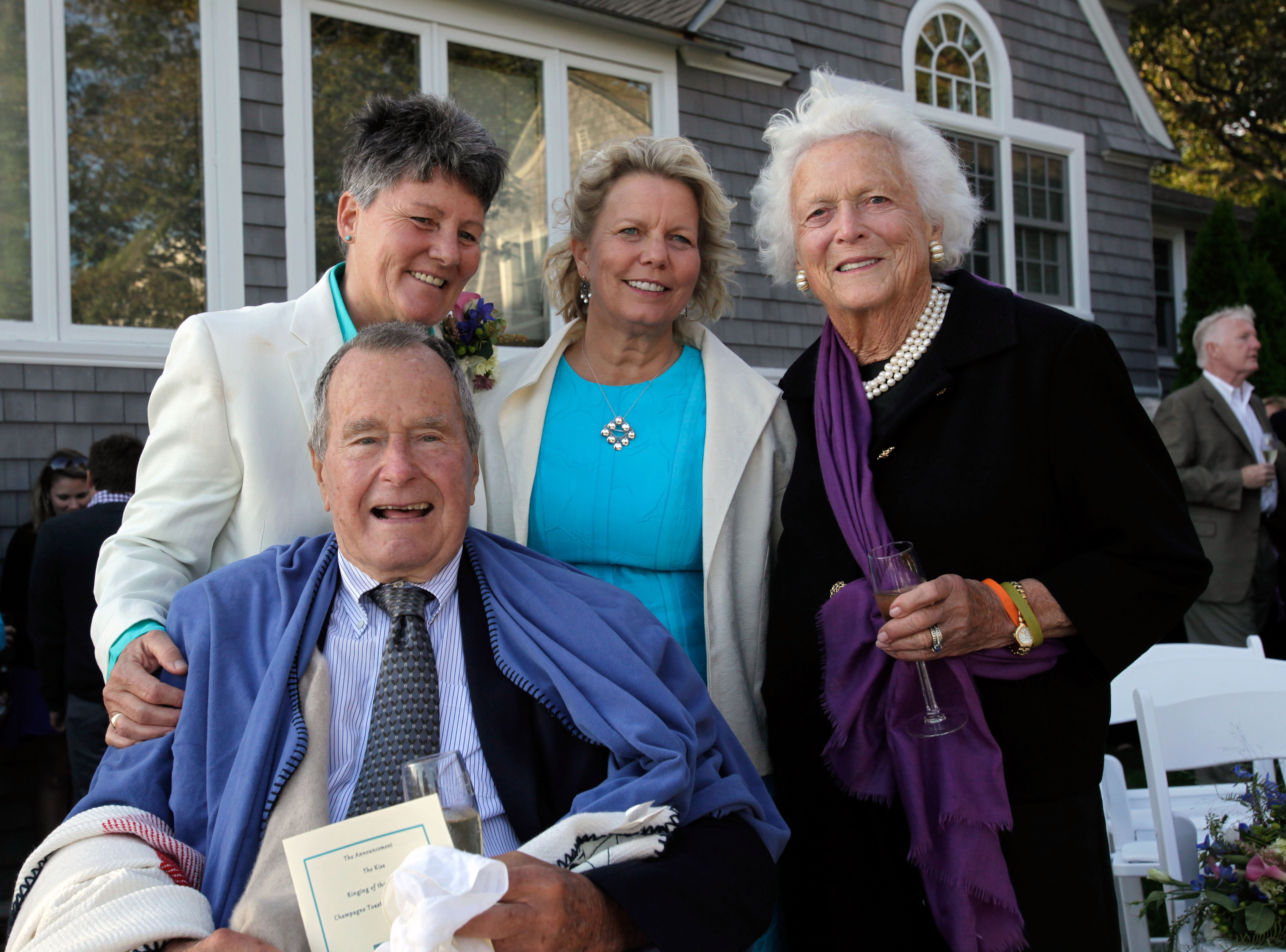 Former President George H.W. Bush and former first lady Barbara Bush pose with the happy couple, longtime friends Helen Thorgalsen, center, and Bonnie Clement.