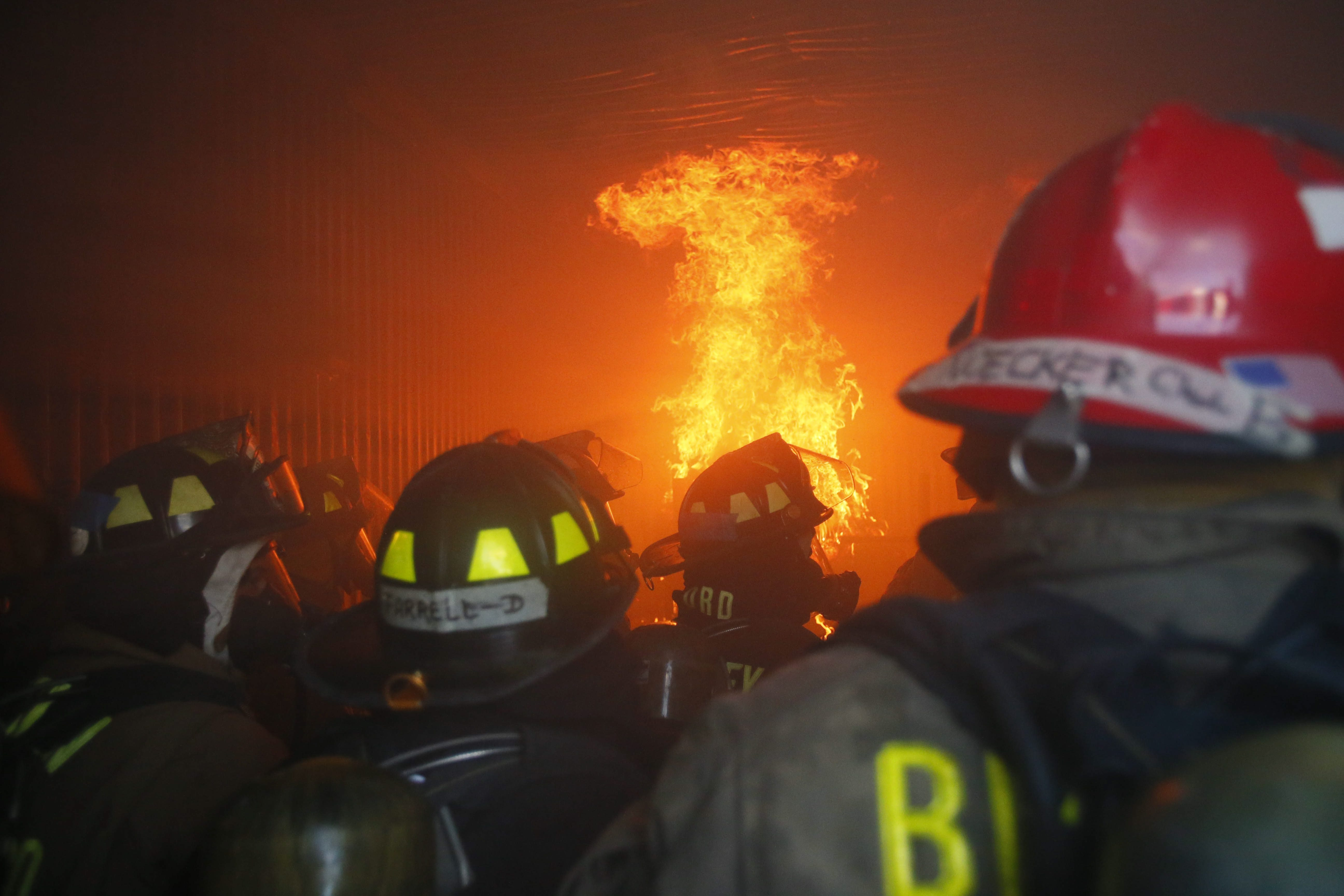 Recruits from 17 area volunteer fire companies take part in a live fire exercise at the Erie County Fire Academy training center in Cheektowaga on Tuesday. The volunteers will graduate Friday.