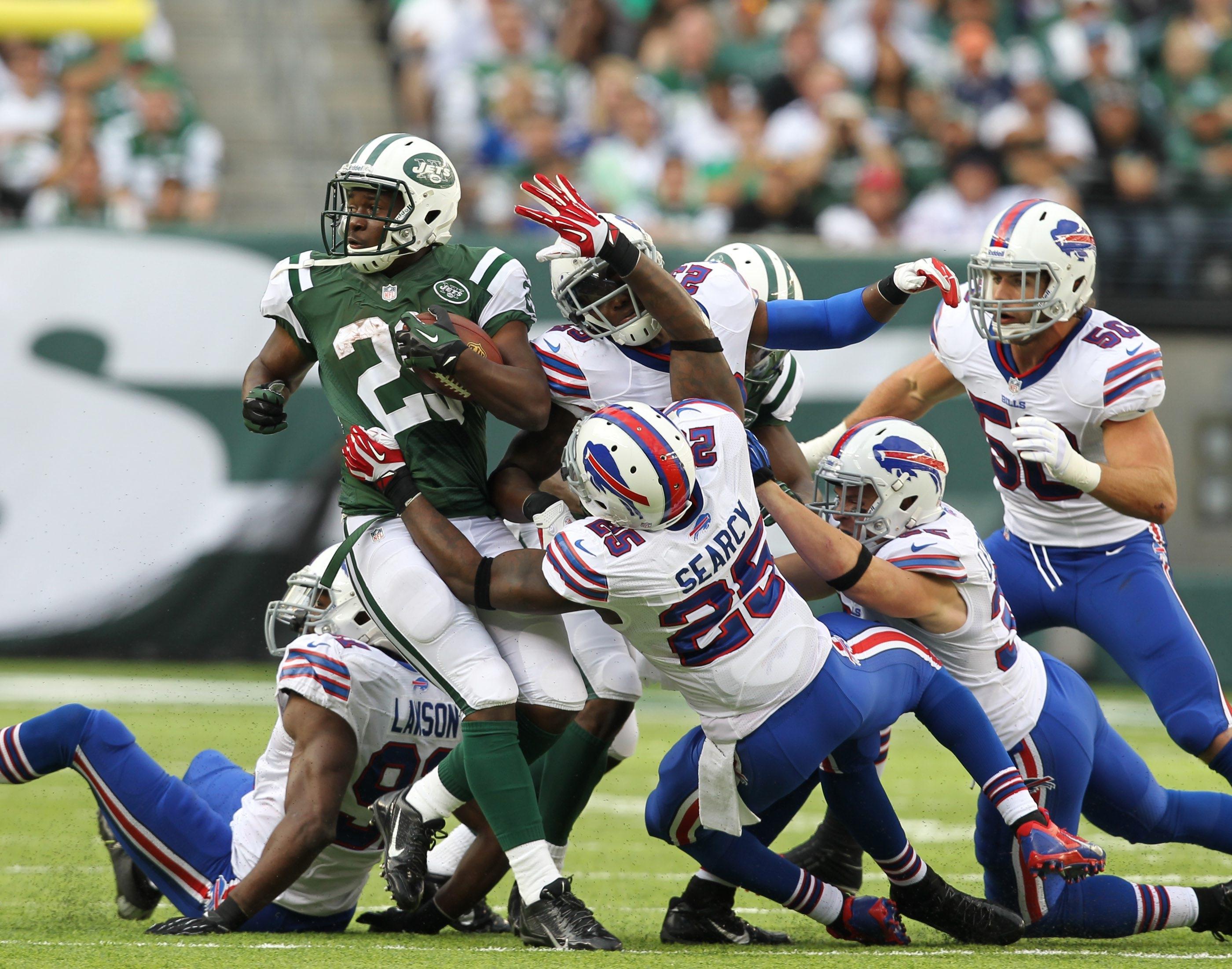 Jets running back Bilal Powell (29) runs over the Bills defense in first half play on Sunday.