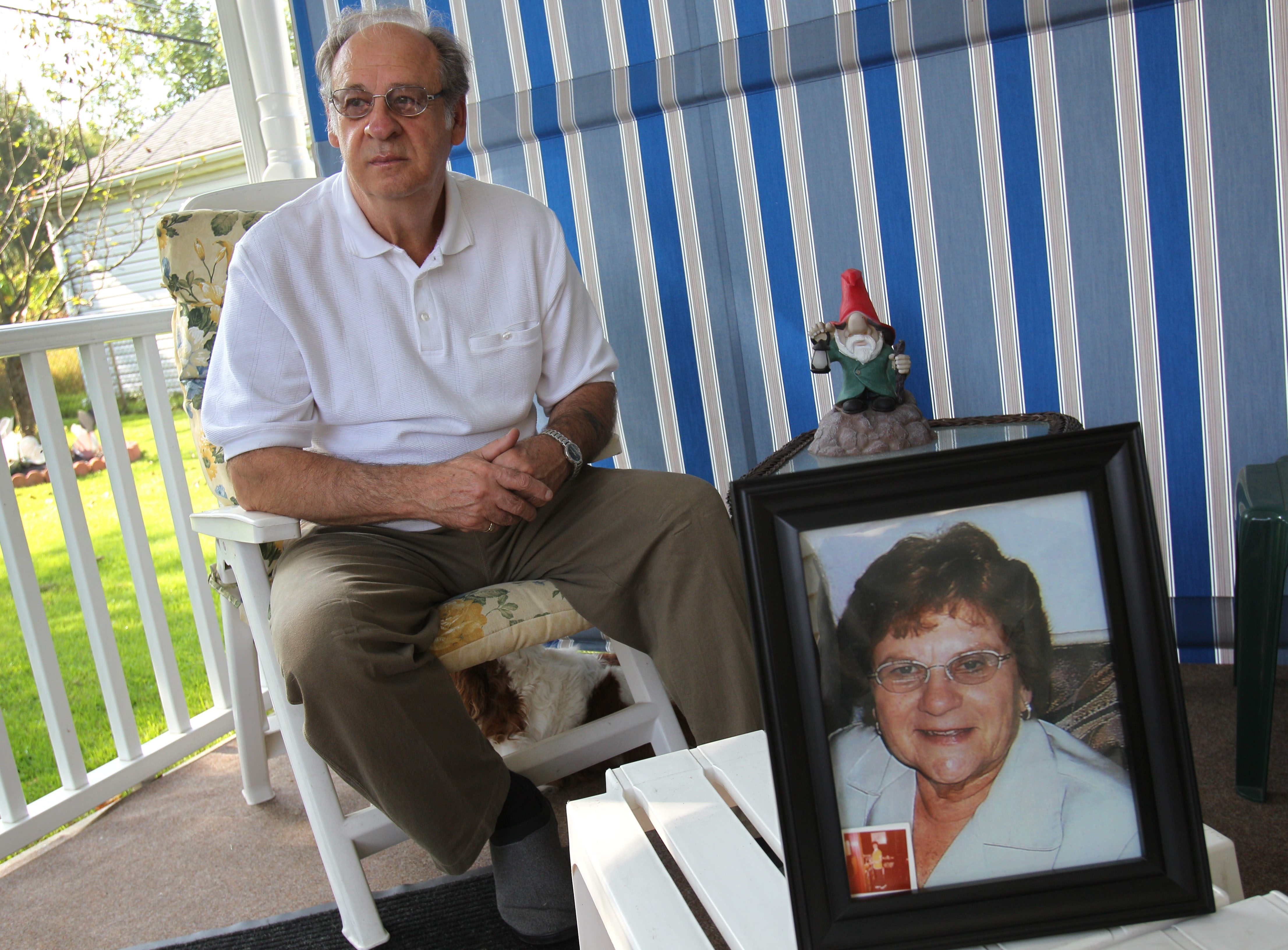 Alphonse Esposito of the City of Tonawanda is one of more than 100 people who wrote impact statements to the judge in the Tonawanda Coke pollution case. His wife died of bone cancer in 2011, and he blames her death on the plant's toxic emissions. He was photographed at home with a photograph of his wife, Joan, on Sept. 20.