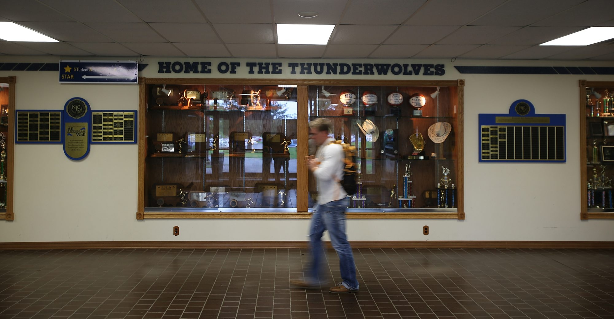 """Home of the Thunderwolves"" trophy case in the NCCC physical education building shows the teams' successes, which have raised  the post-season budget and stifled the college's ability to fund new sports."
