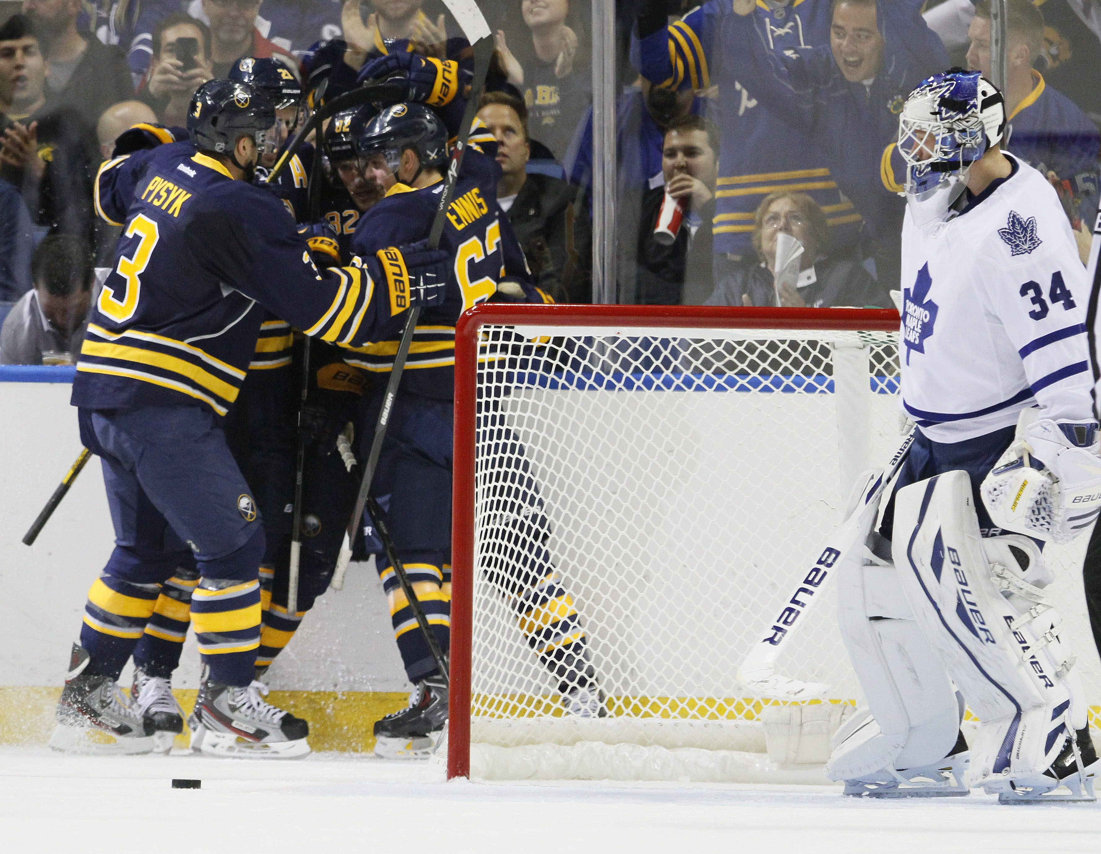 Buffalo's Marcus Foligno (82) celebrates his second-period goal with teammates during Saturday's game against Toronto.