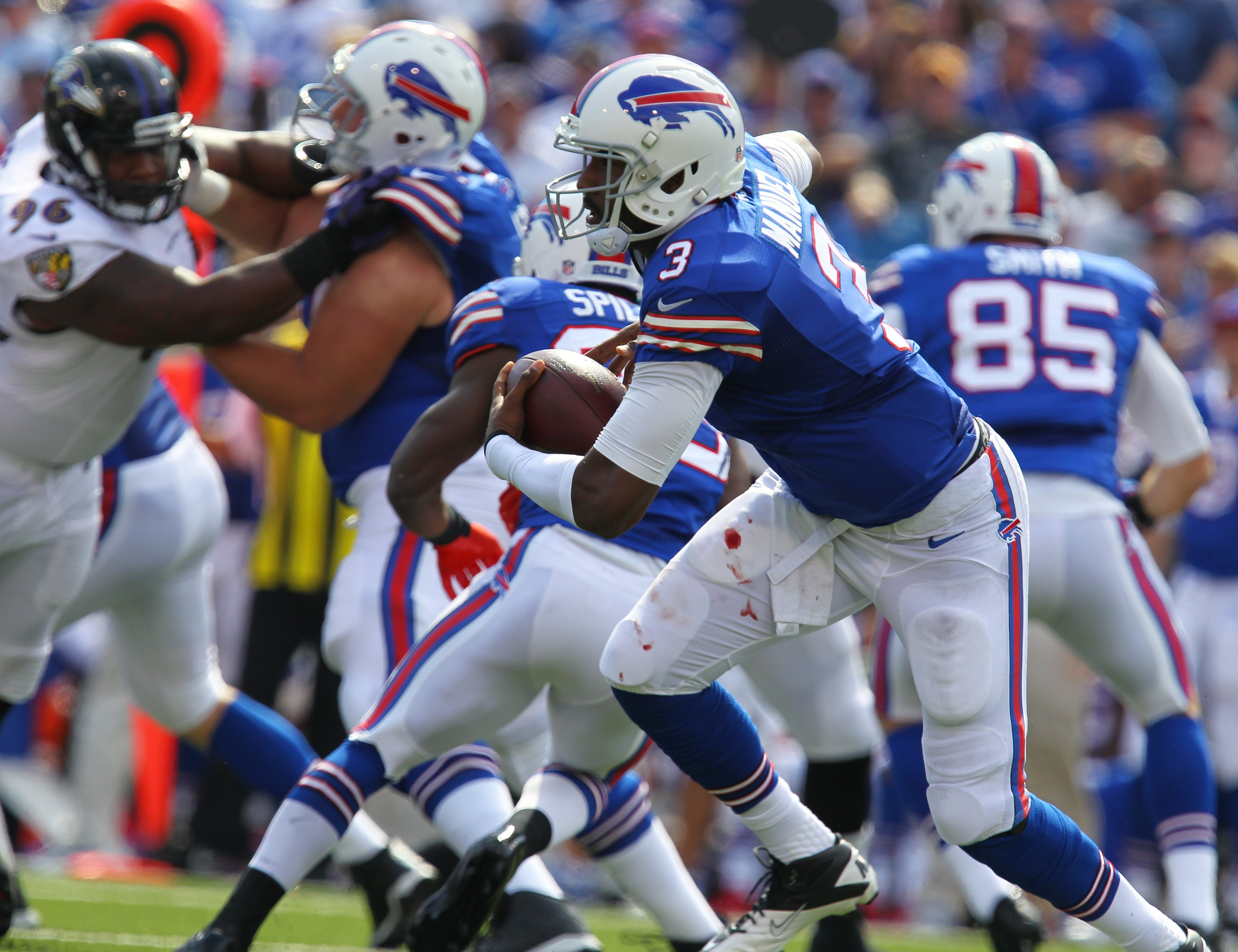 The Bills' EJ Manuel gains a few yards in the first quarter at Ralph Wilson Stadium against the Ravens.  (Mark Mulville/Buffalo News)