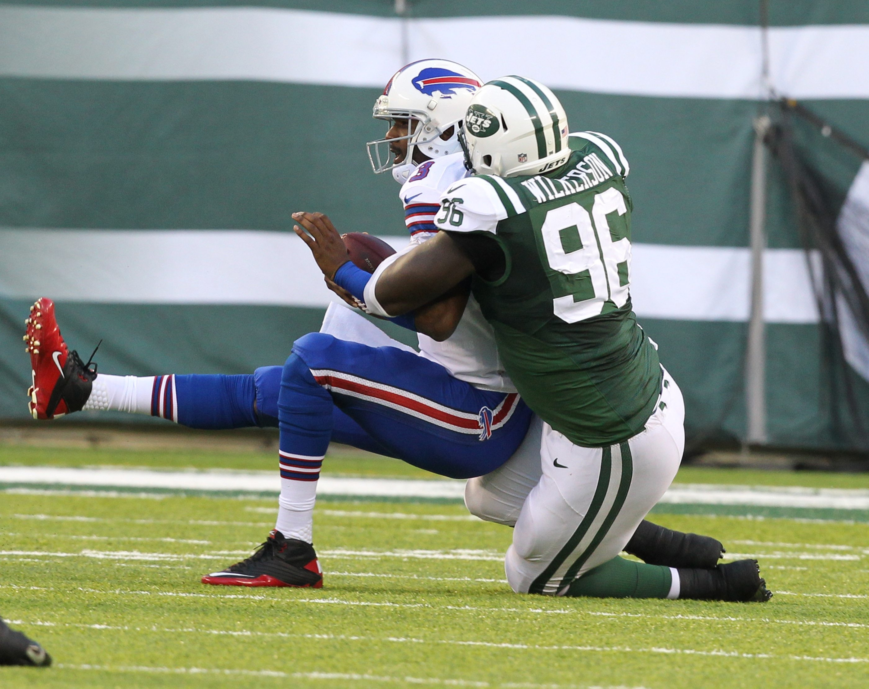 Buffalo Bills quarterback EJ Manuel is sacked by New York Jets defensive end Muhammad Wilkerson (96) in the second quarter.  {James P. McCoy/ Buffalo News}