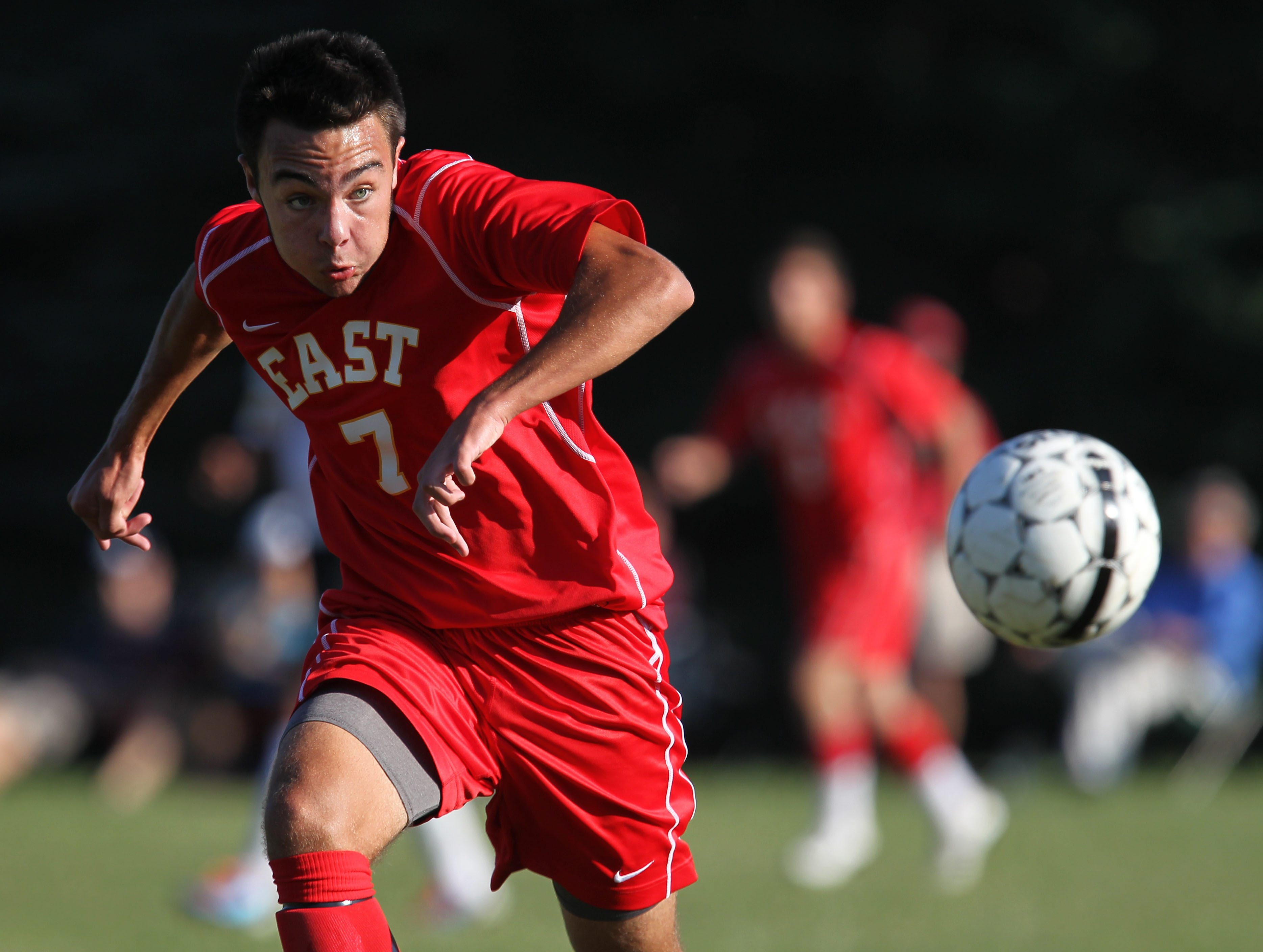 Williamsville East's Dan Griffin chases down a loose ball during the first half of the game against Hamburg on Thursday. Will East defeated Hamburg, 2-1.