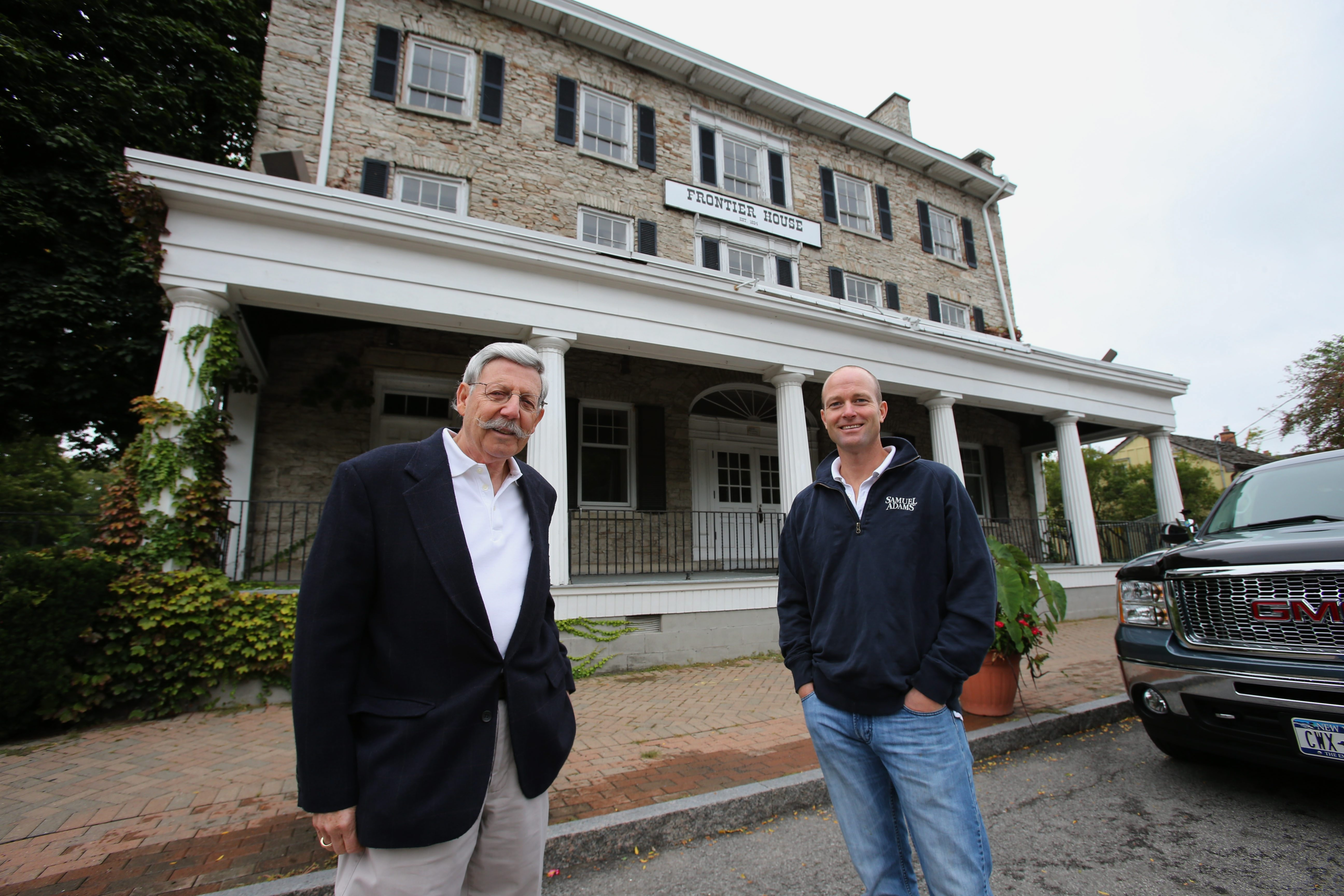 Lewiston Mayor Terry C. Collesano, left, joins Alan J. Hastings at historic Frontier House, which Hastings is hoping to turn into a microbrewery. The structure has been vacant since 2004, and the village is trying to get a state grant to expedite redevelopment.
