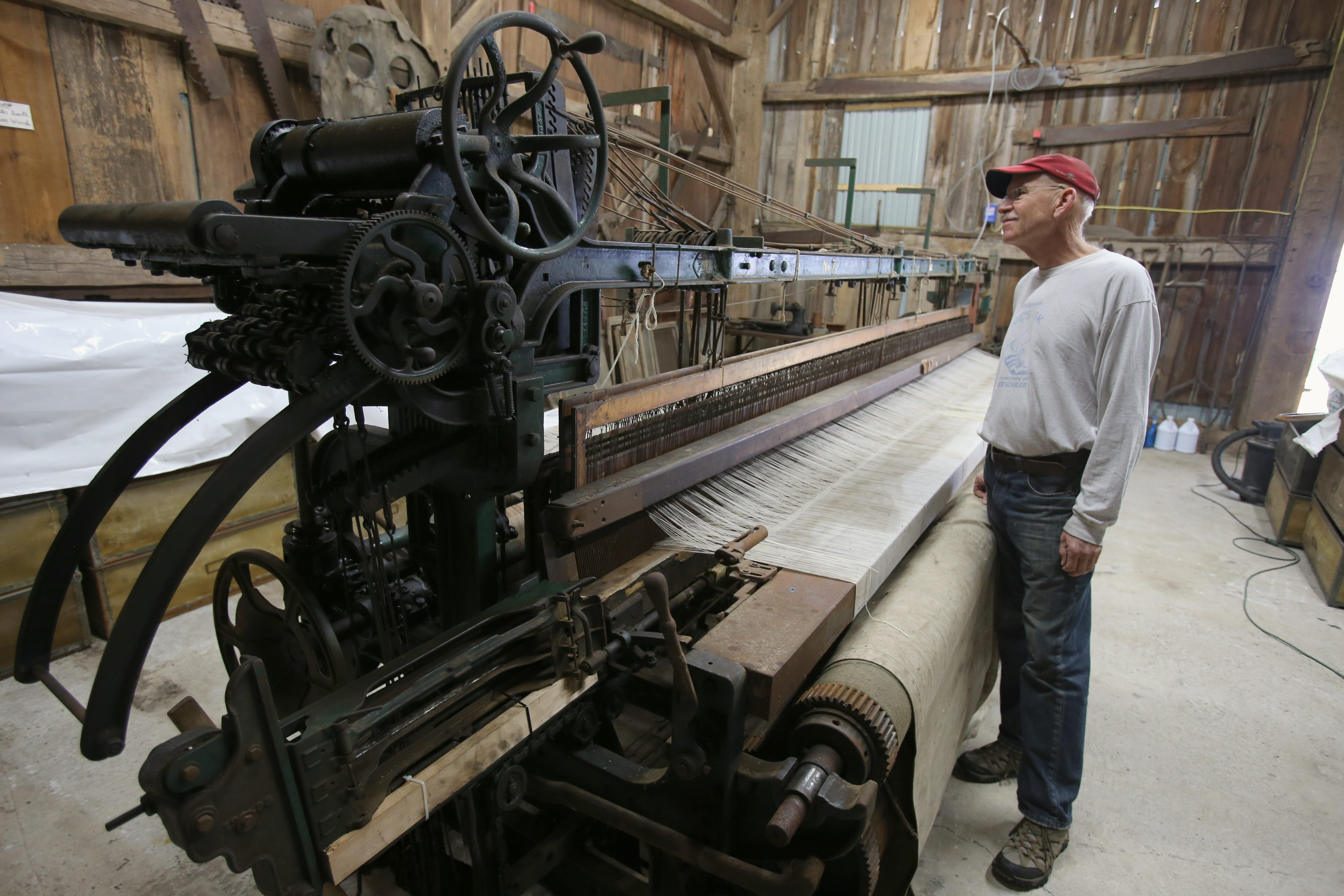 Bill Neidlinger, a Historical Society board member at the Town of Newfane Historical Museum, looks over a 1933 Crompton & Knowles steel loom in the museum.