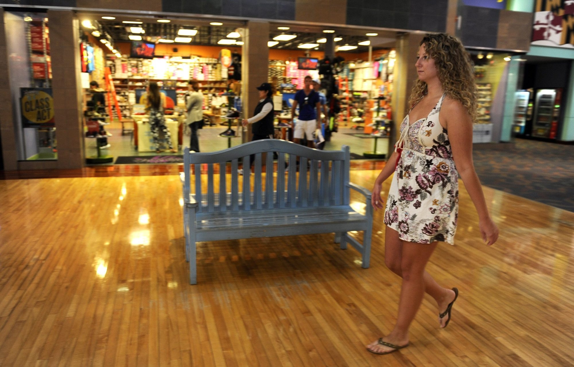 Liz DeRubertis, 26, strolls through the Arundel Mills Mall in Hanover, Md. Generation Y shoppers show a preference for the brick-and-mortar experience.