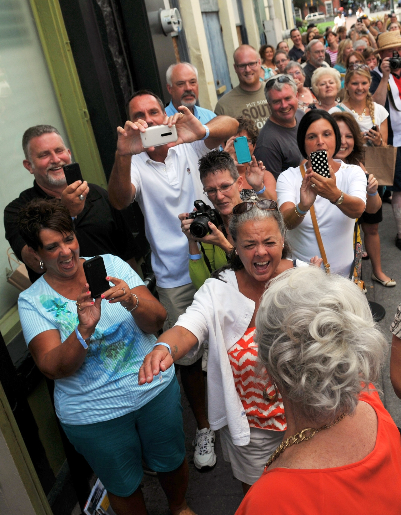 We love you, Paula: Paula Deen, lower right, greets the fans at a book-signing event in Savannah, Ga., on Thursday.