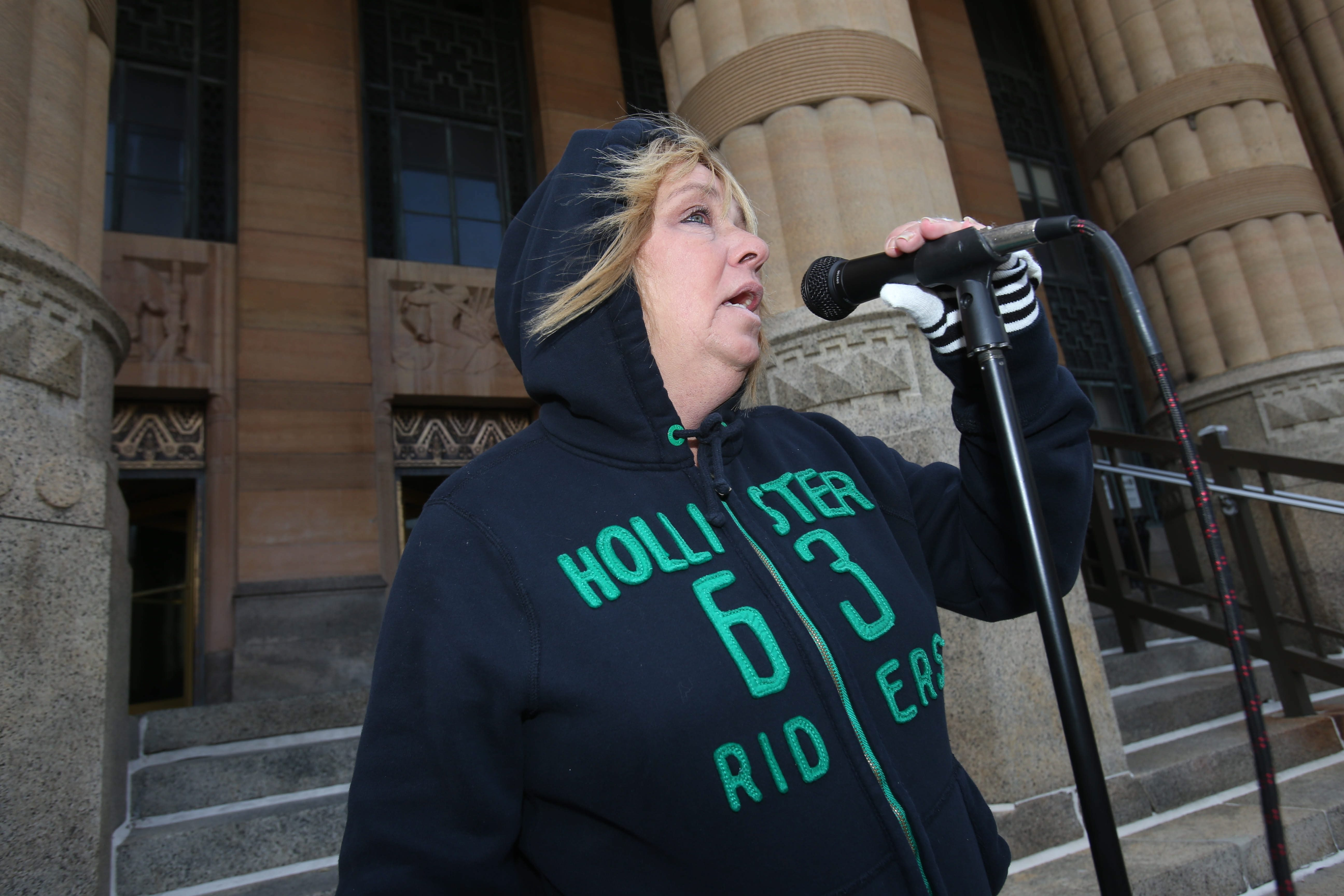 Leslie Brill demands answers in the death of her daughter, Amanda Wienckowski, as family and friends held their annual vigil Sunday in front of City Hall.