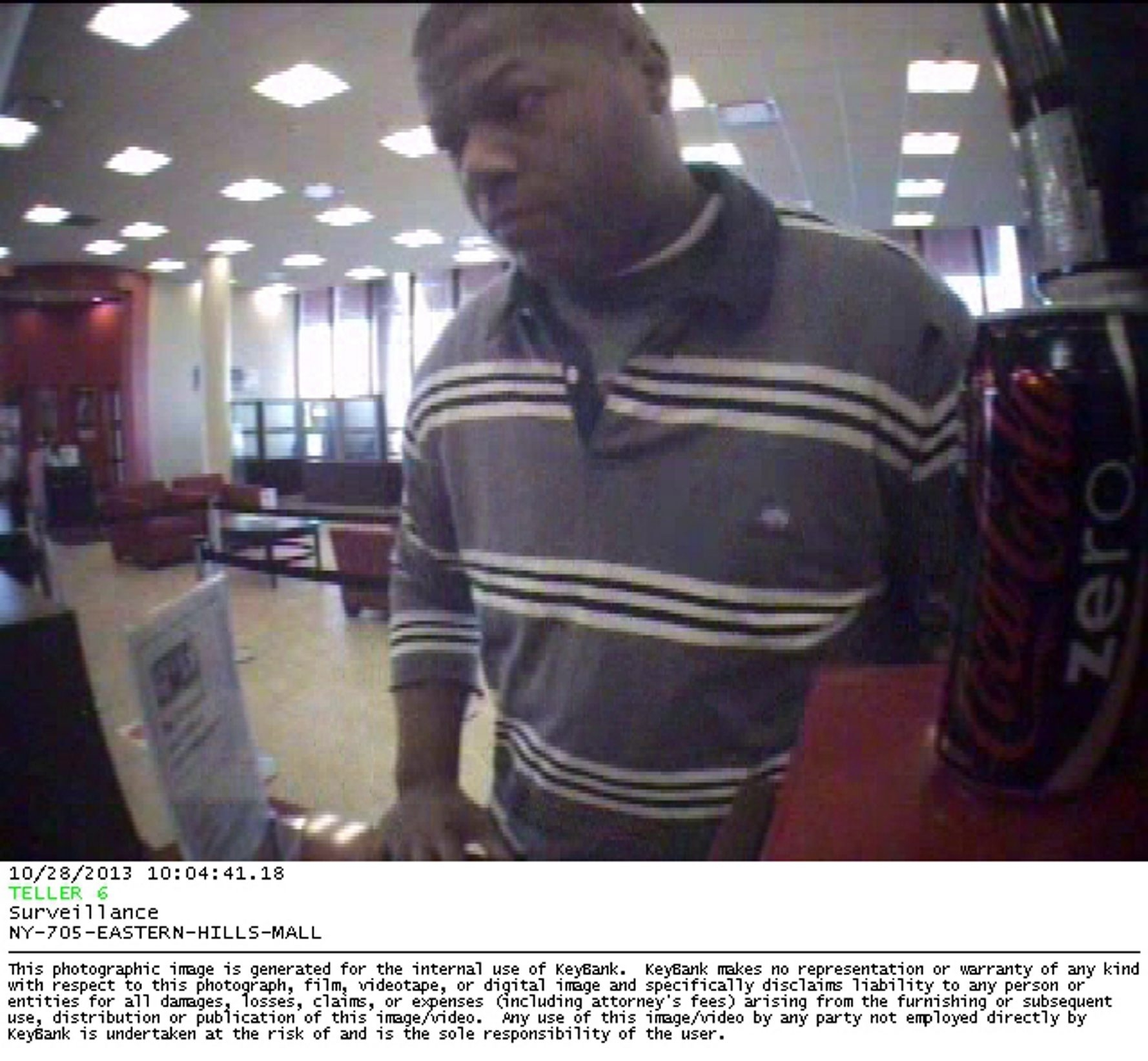 An image provided by KeyBank shows the man who robbed a Clarence branch of an undetermined amount of cash at about 10 a.m. Monday.
