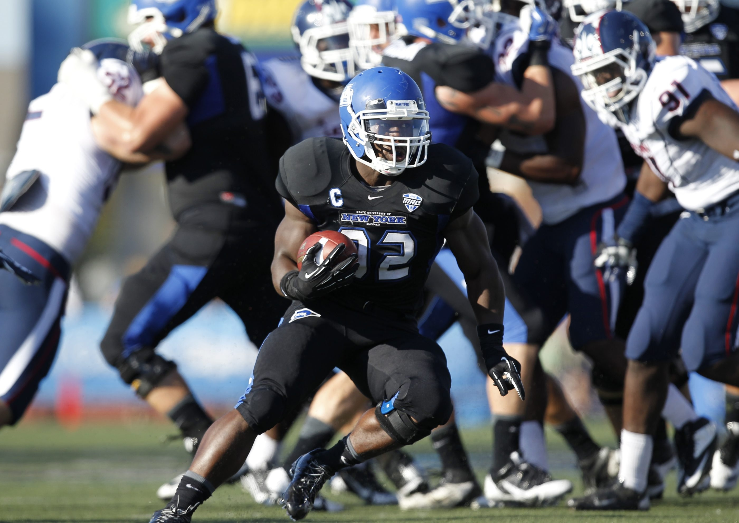 Running back Branden Oliver is one of 21 seniors who will play in UB Stadium for the last time Tuesday.  University at Buffalo football player,Bo Oliver runs upfield during the second quarter,in action against Connecticut at UB Stadium,on Saturday, Sept. 28, 2013.(Harry Scull Jr./Buffalo News)